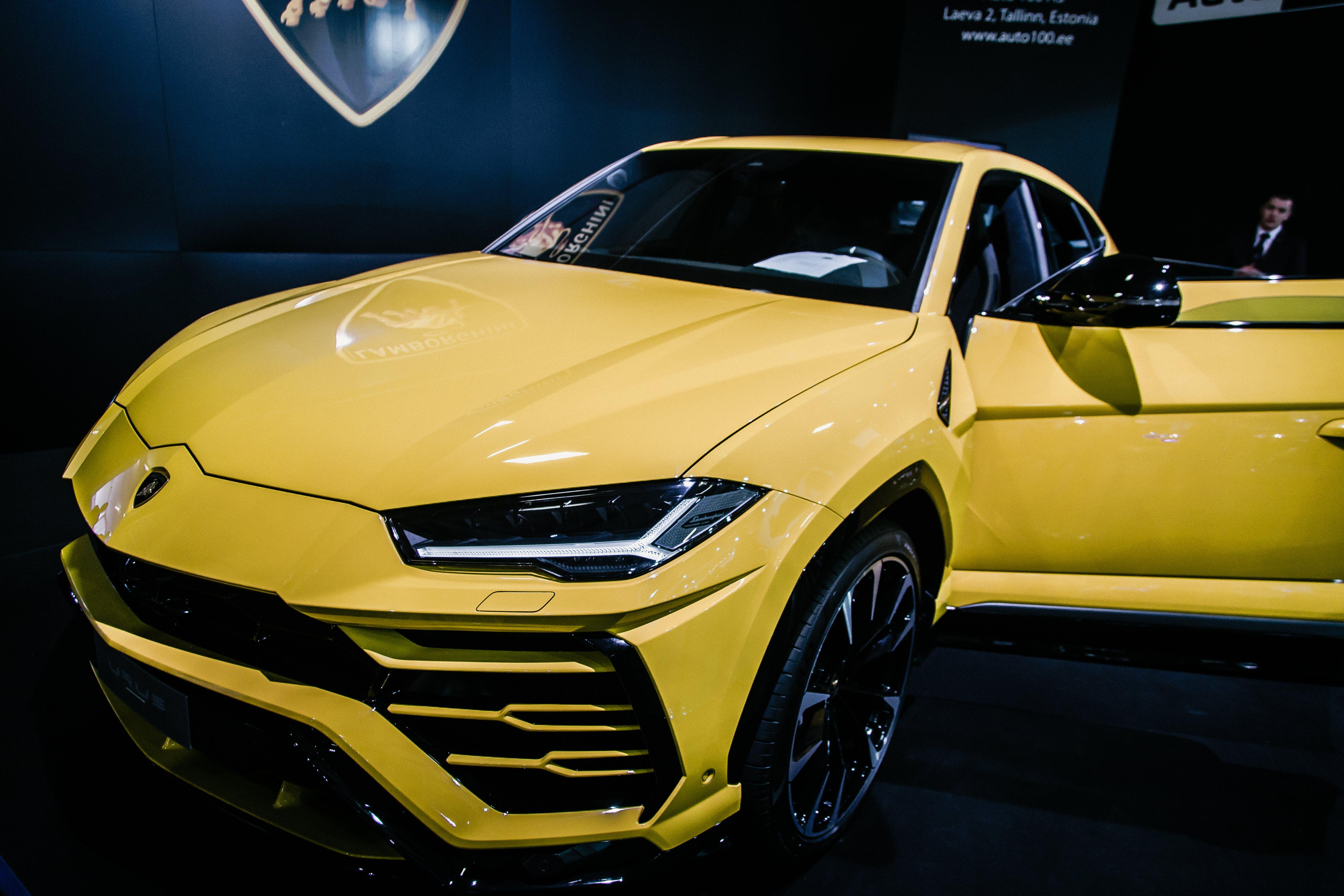 Yellow Luxury Car Near Man