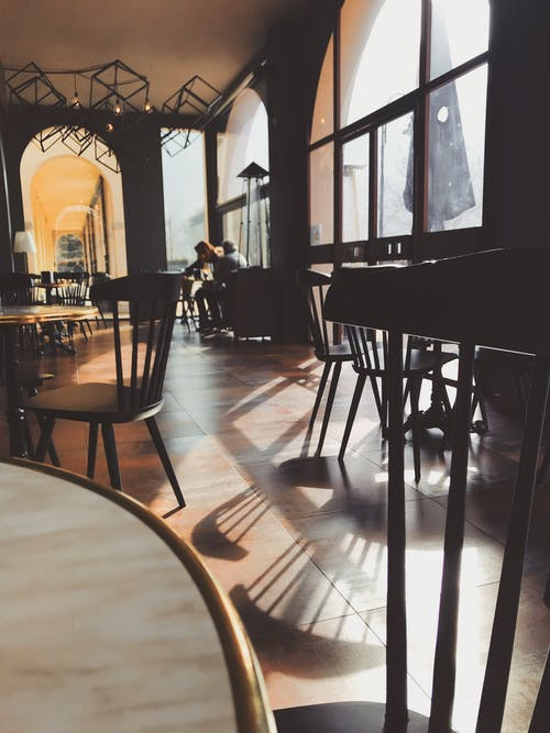 Photo of Black Wooden Dining Chair on Restaurant