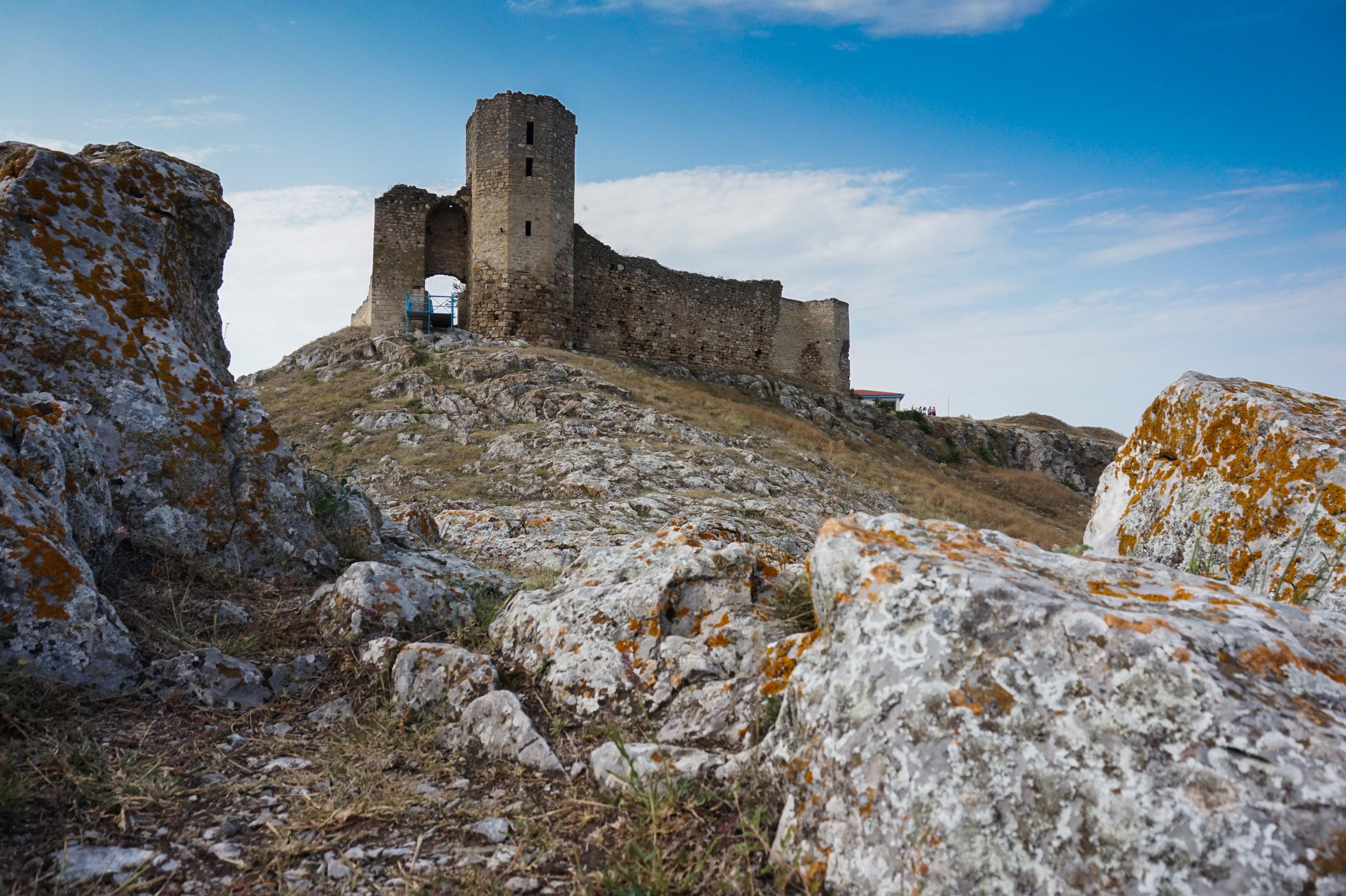 Gray Concrete Castle Under Blue and White Sky