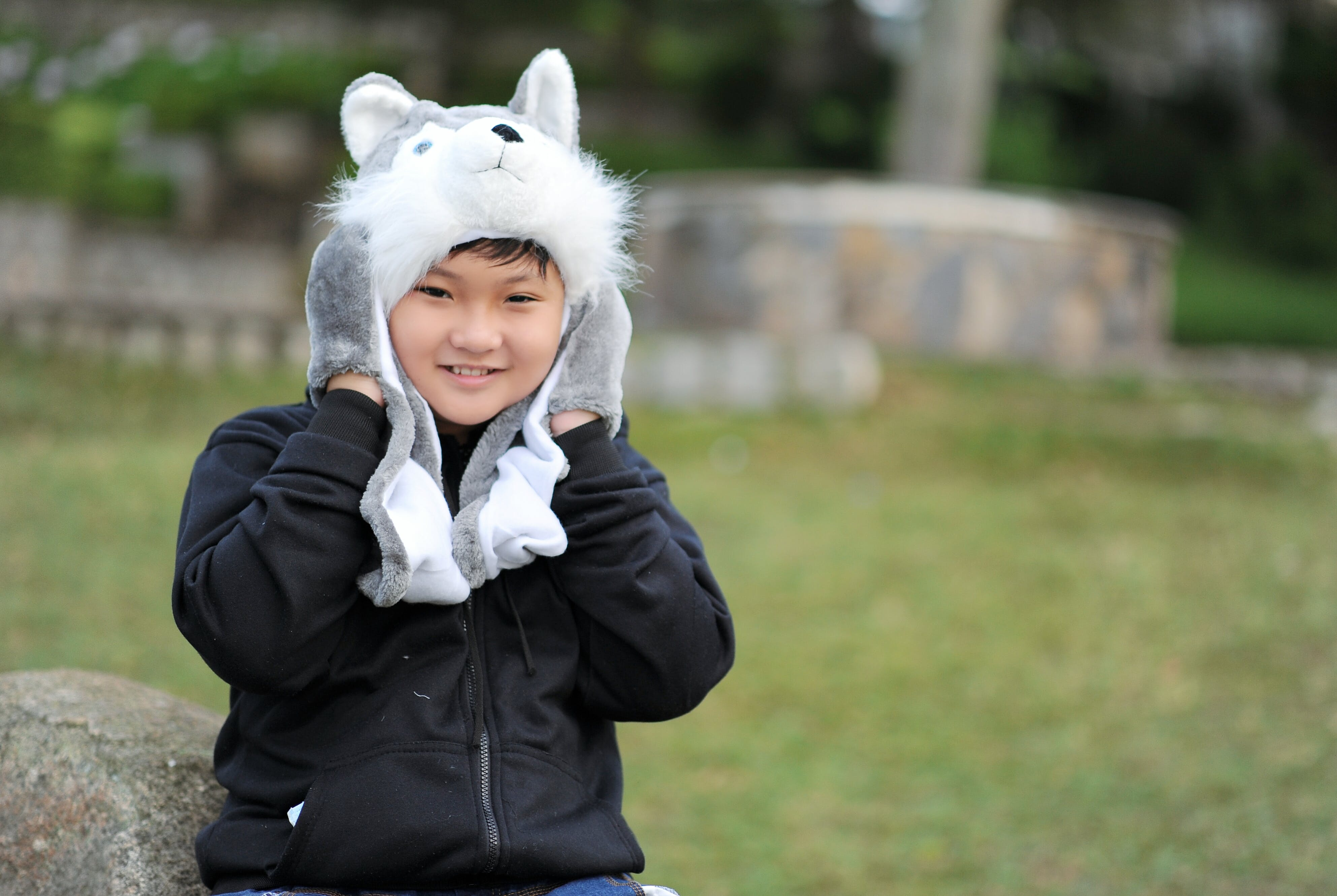 Kid Wearing Gray Wolf Critter Hat and Black Jacket