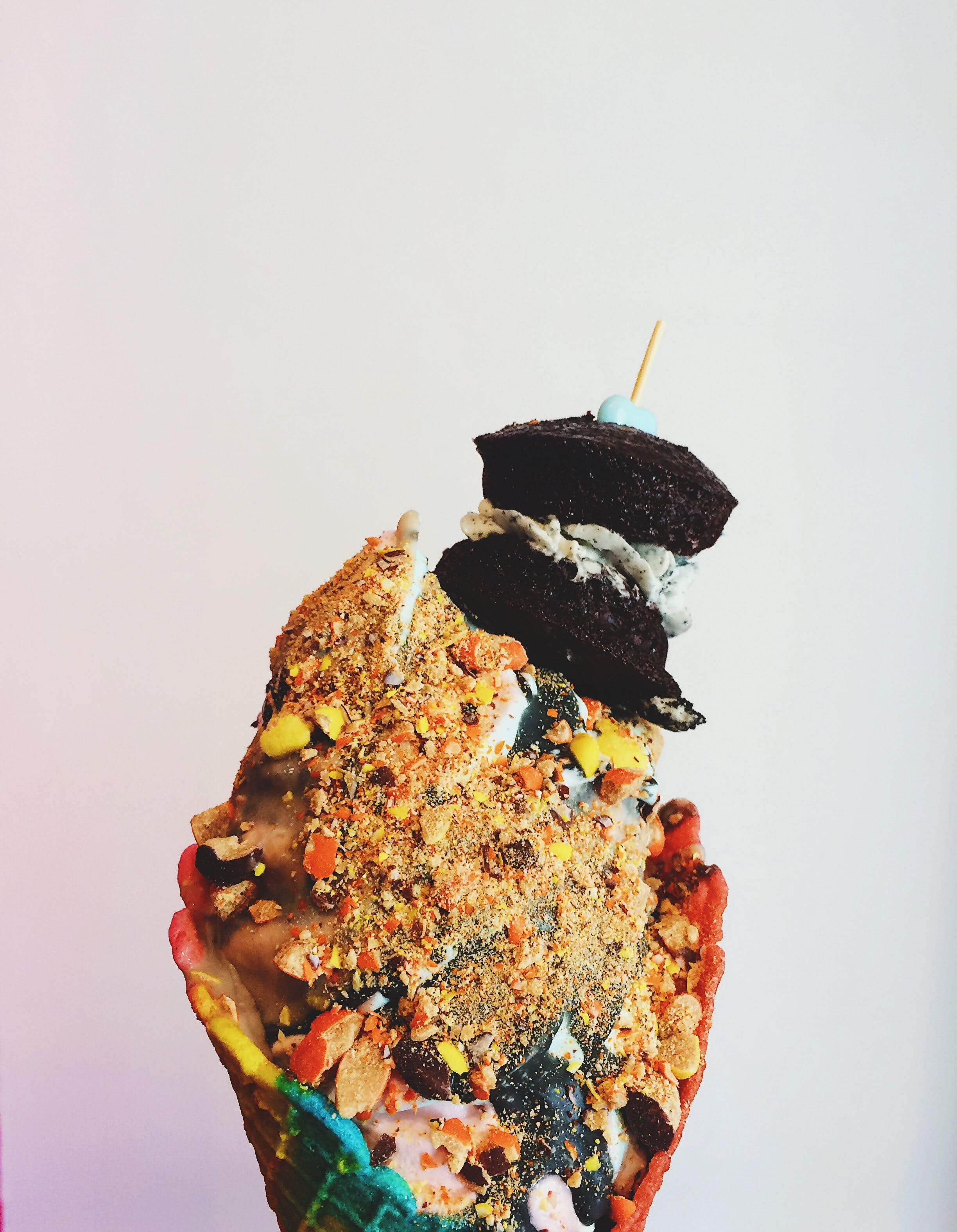 Ice Cream on Cone With Crushed Peanuts and Brownies