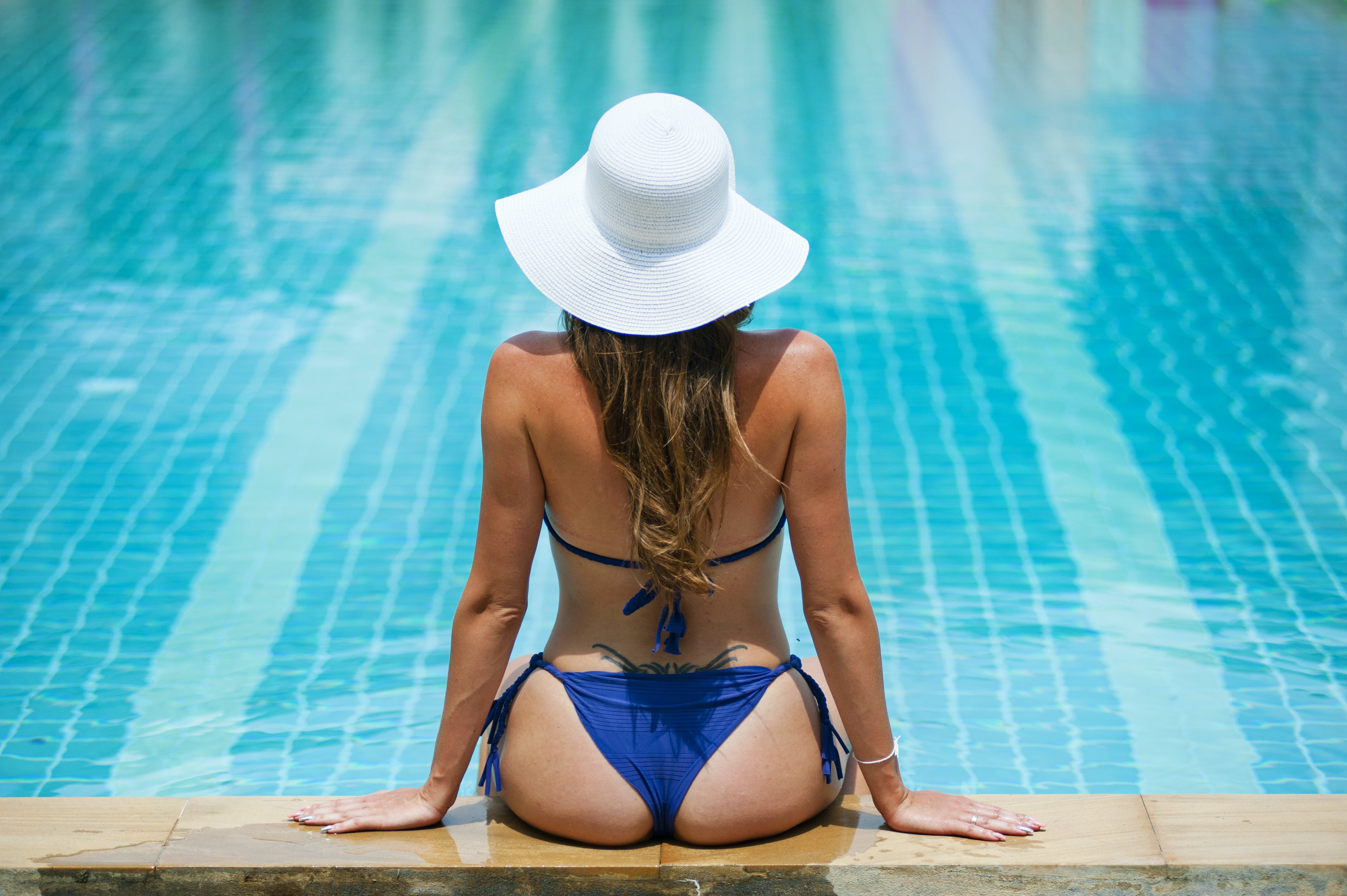 Woman With Blue String Bikini And White Sun Hat