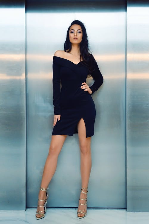 Woman Wearing Off-shoulder Long-sleeved Mini Dress