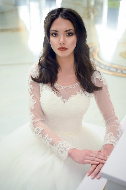 Women in White Long-sleeved Bridal Gown