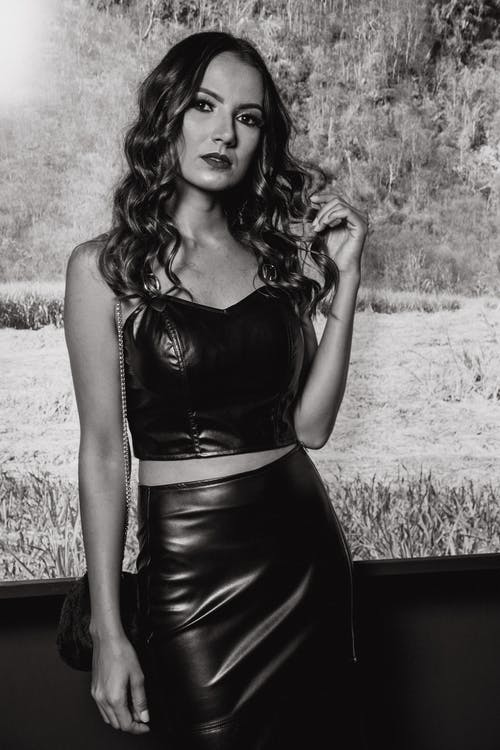 Monochrome Photography of Woman Wearing Black Leather Strapless Crop Top and Black Pencil Skirt
