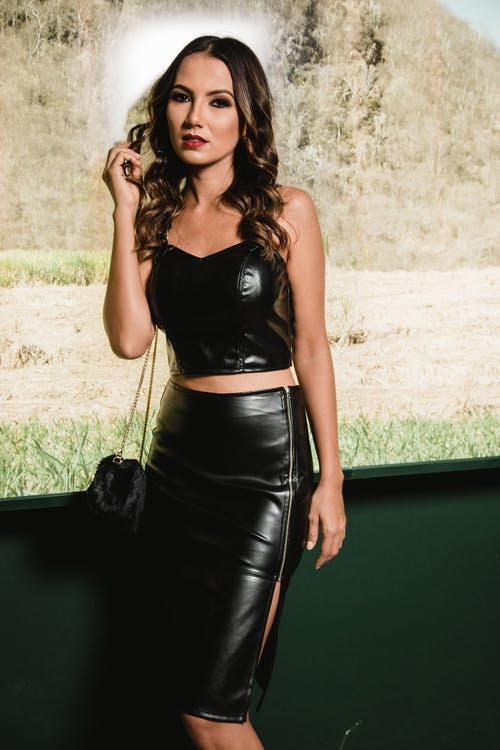 Photography of Woman Wearing Black Leather Strapless Crop Top and Black Pencil Skirt