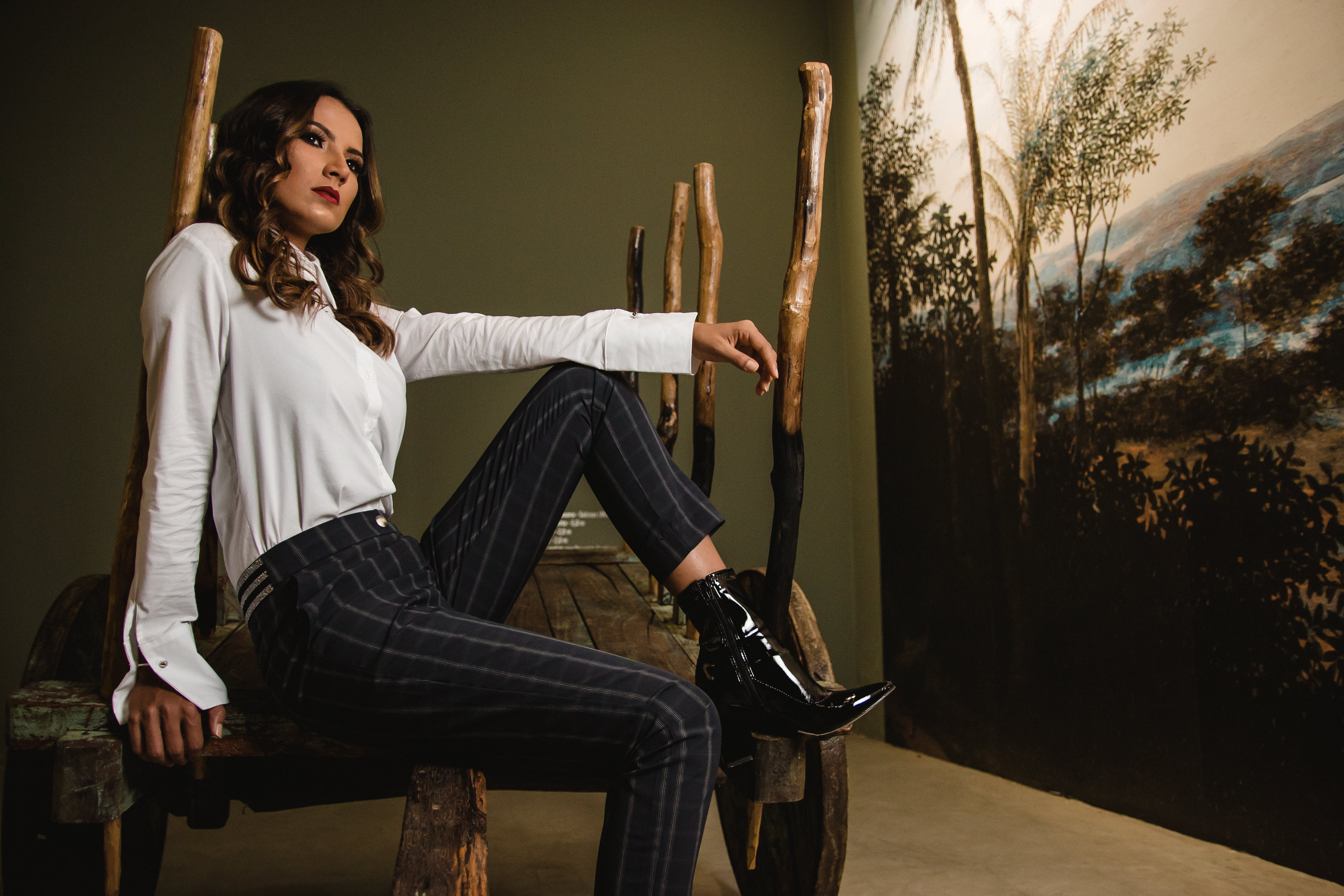 Photo of Woman Sitting on Wooden Chair
