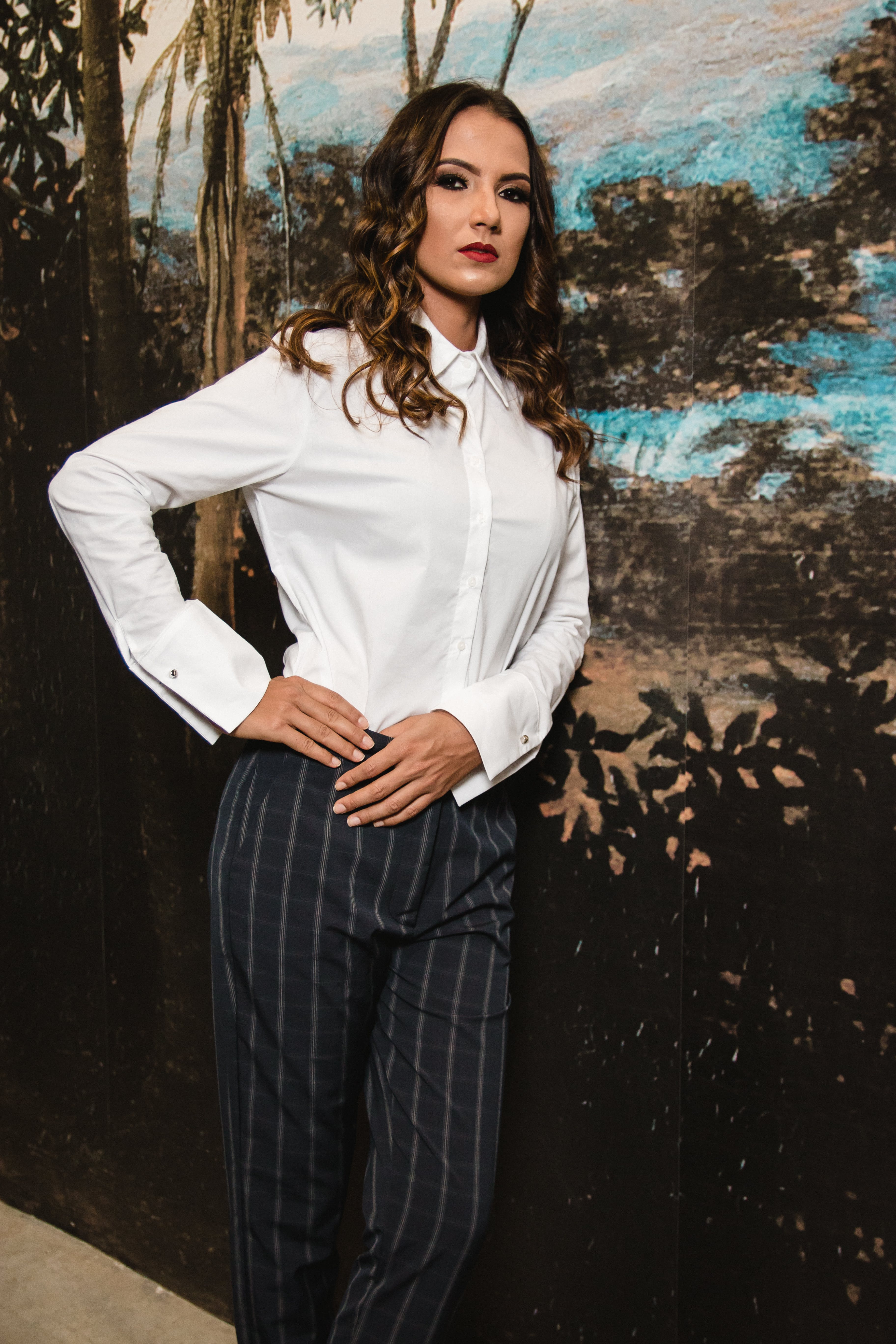 Woman Posing in Collard Long-sleeved Shirt and Grey Pants