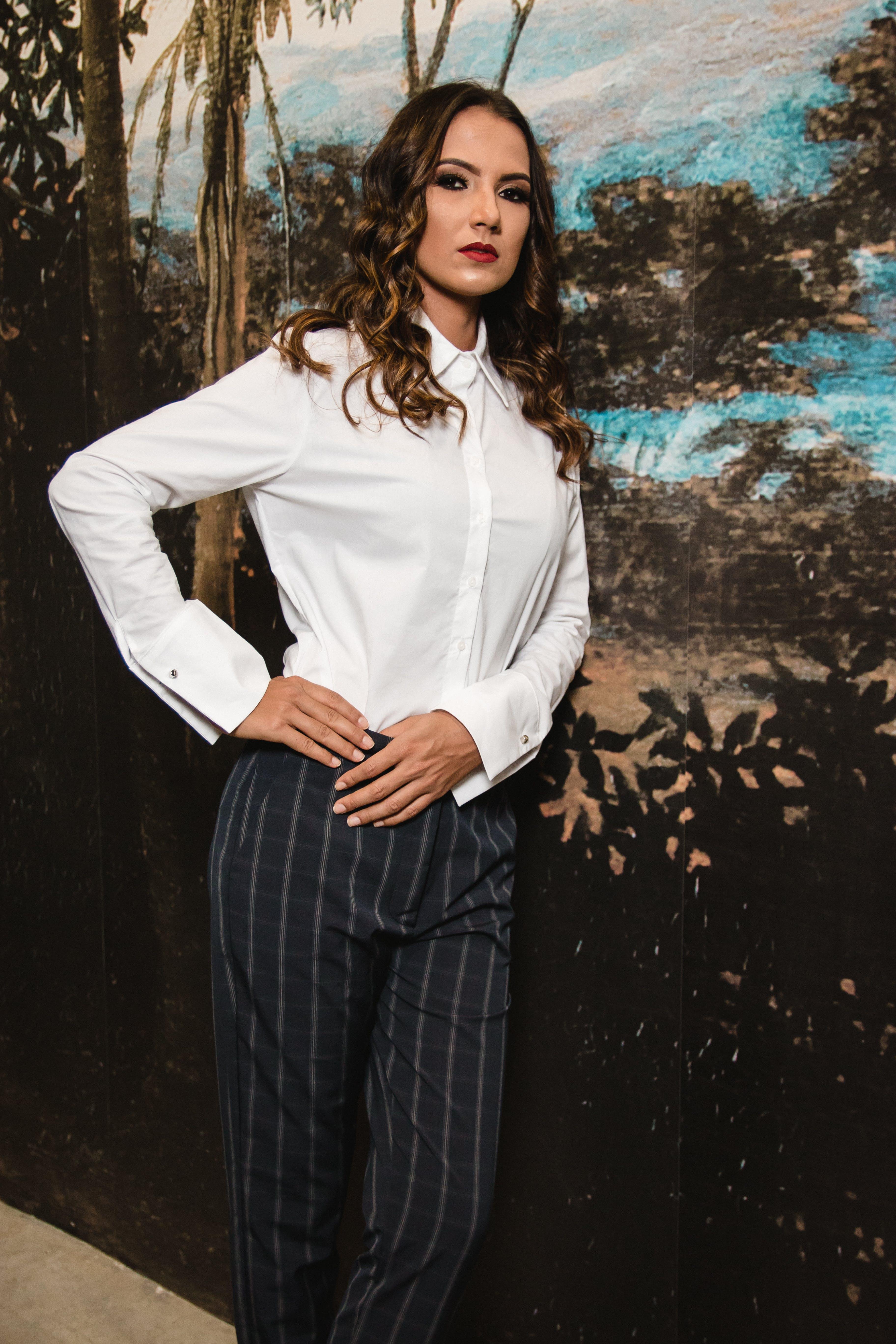 Woman Posing in Collard Long-sleeved Shirt and Grey Pants