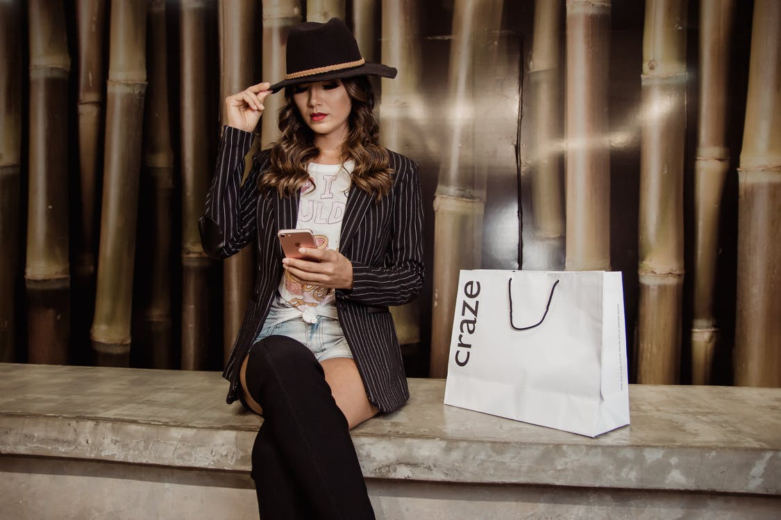 Photo of Woman Sitting Near Paperbag