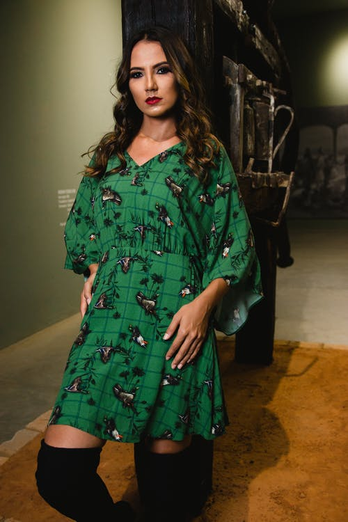 Photo of Woman Wearing Green Dress