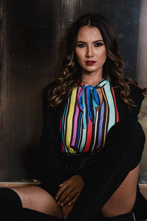 Photo of Woman Wearing Multi-colored Top