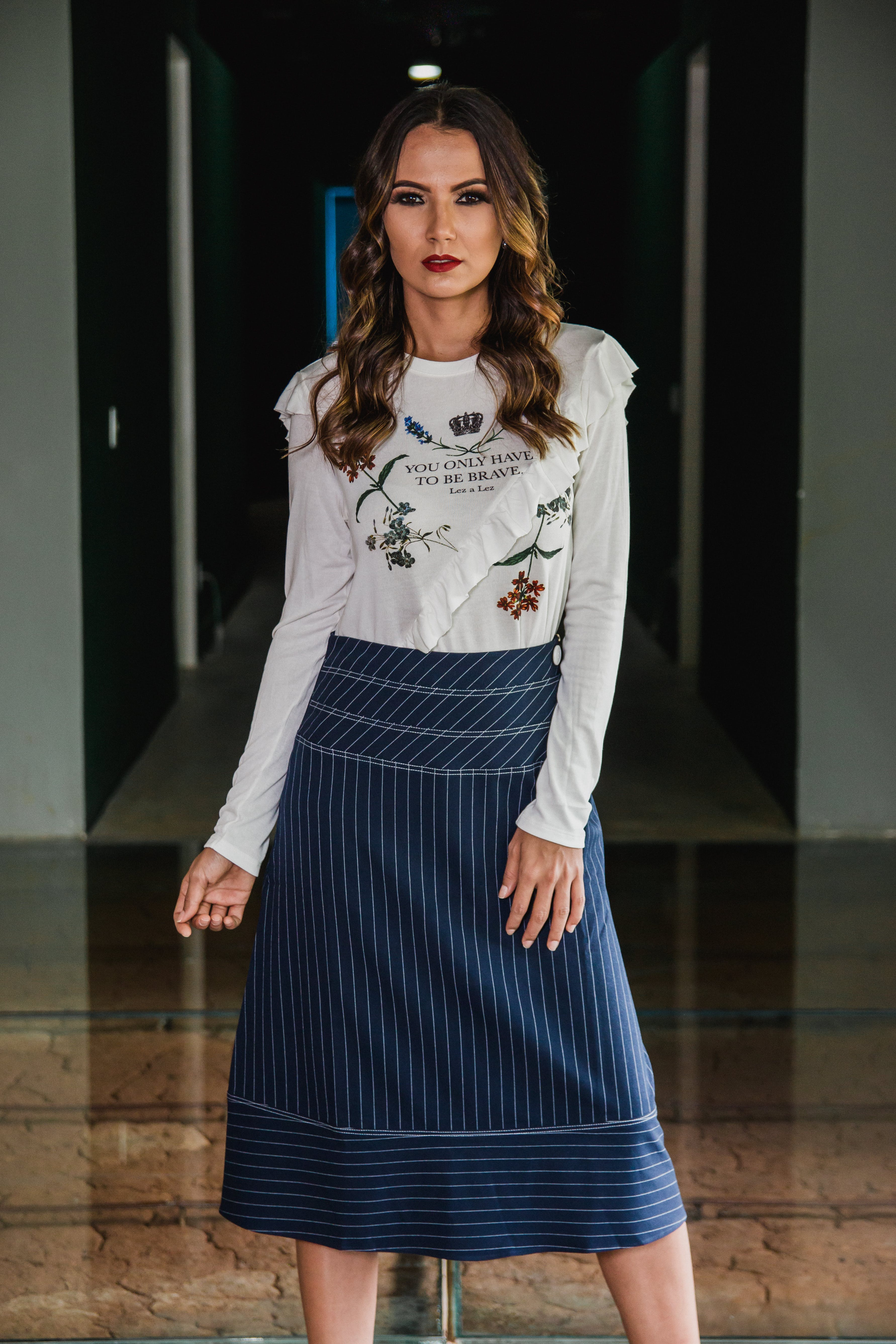 Photo of Woman Wearing Long sleeved Top and Long Skirt