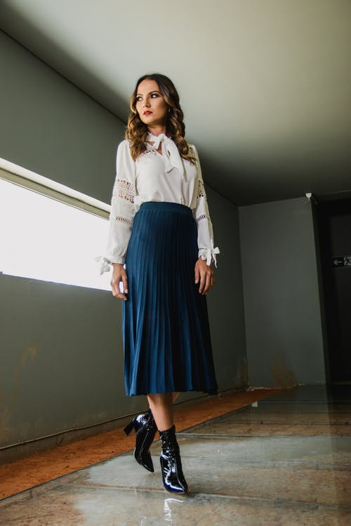 Woman Wearing White Long-sleeved Shirt and Blue Skirt