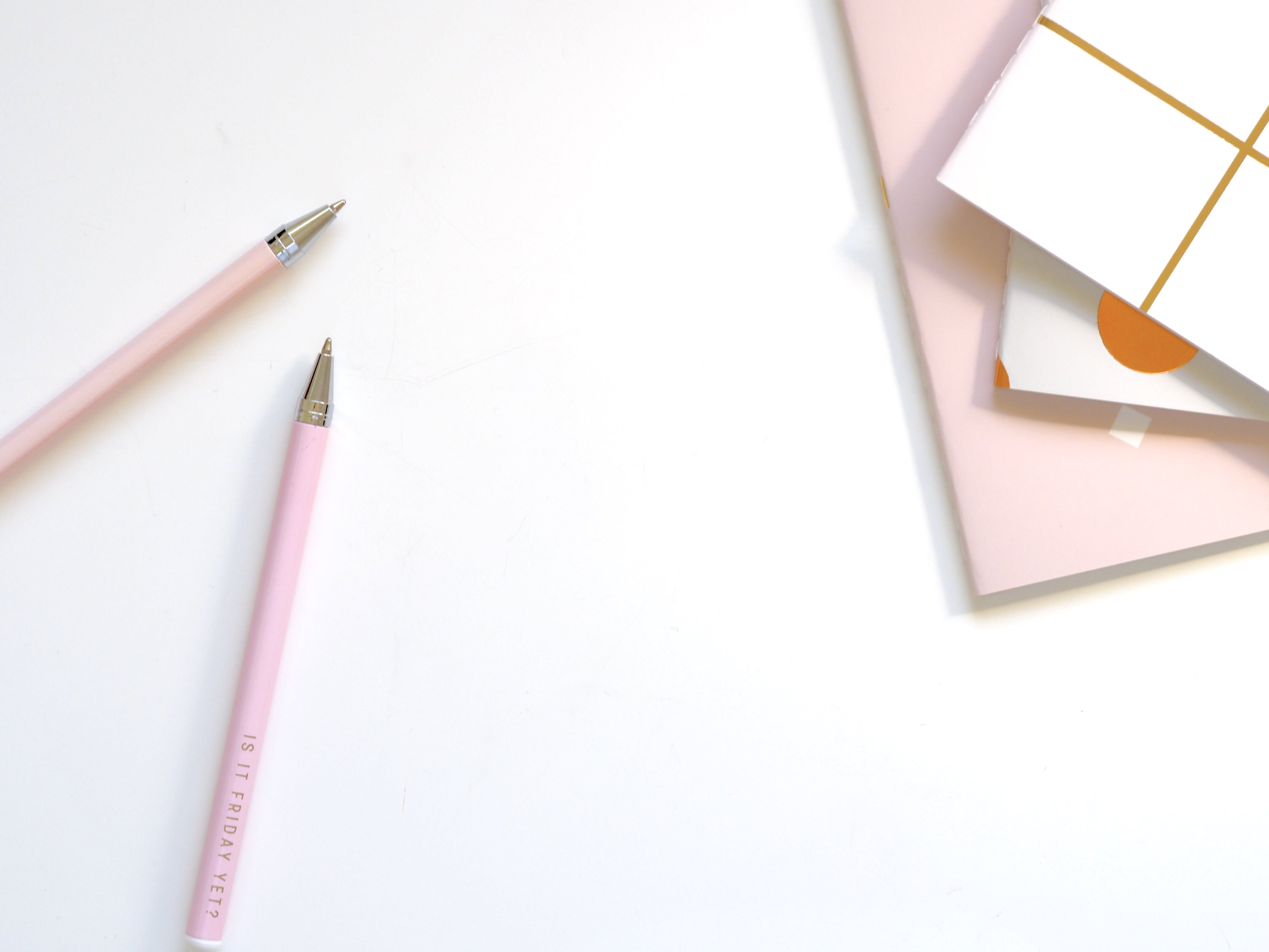 Two Pink Ballpoint Pens on Table