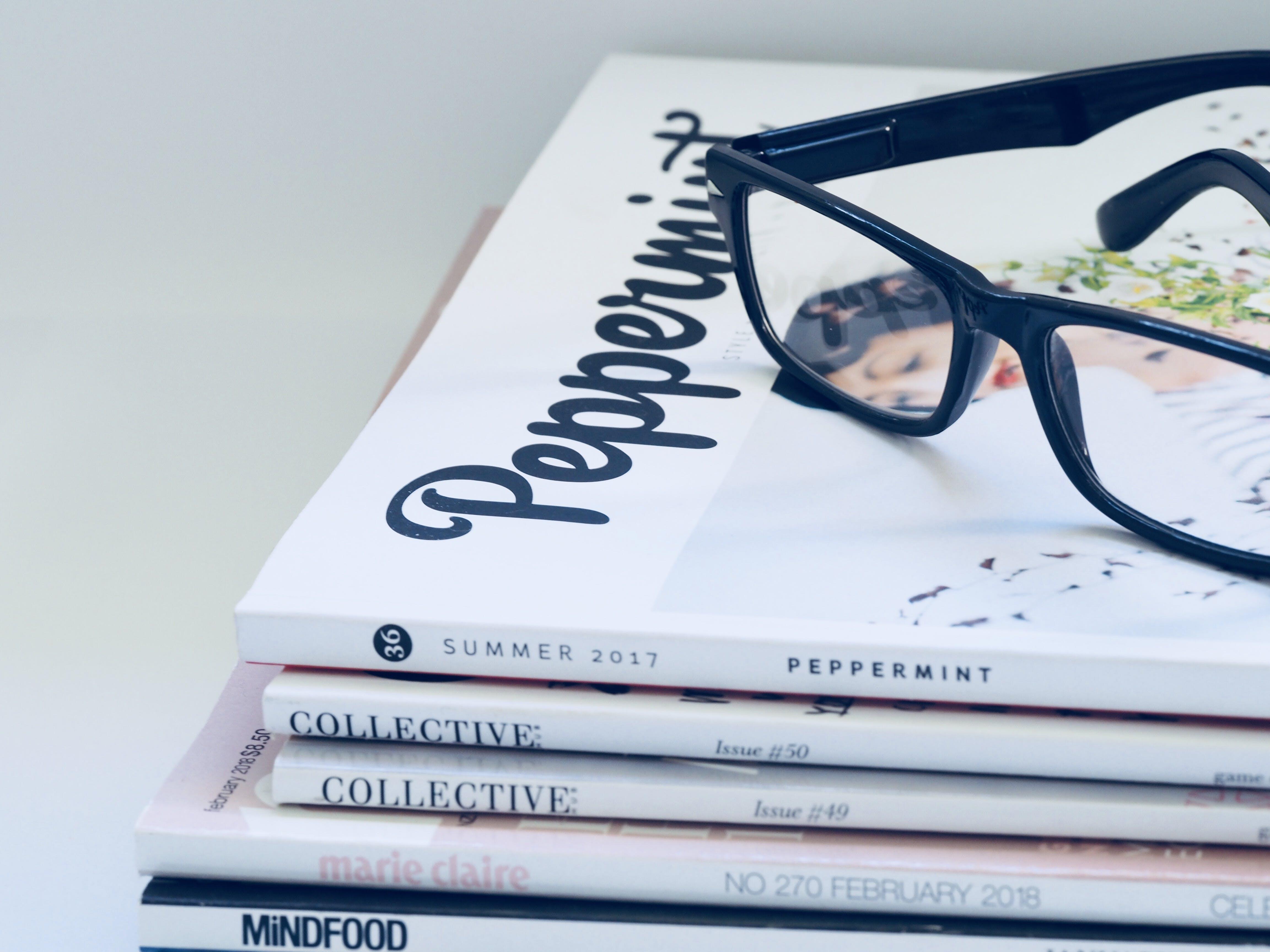 Photo of Eyeglasses On Top of Magazines