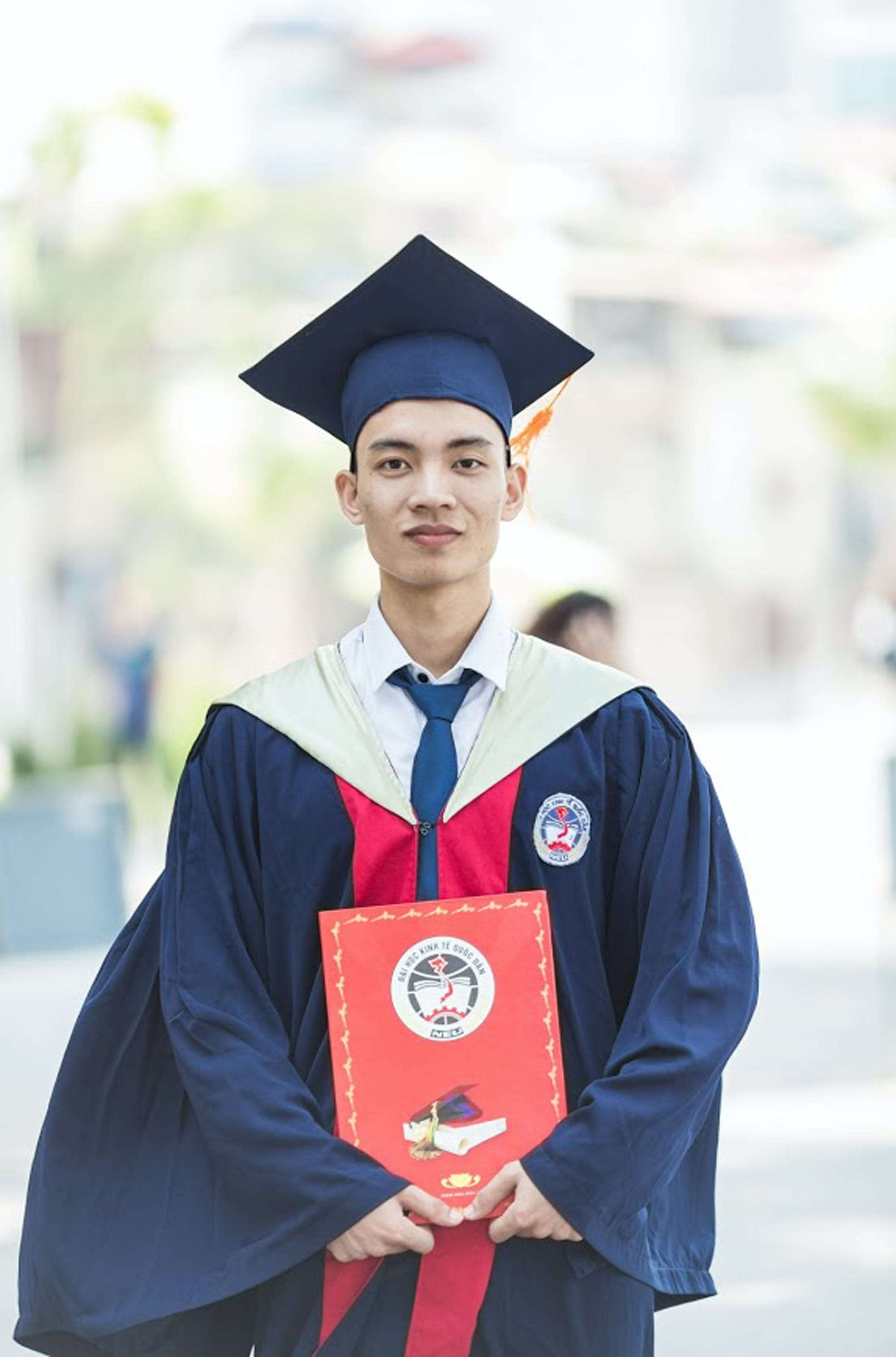 Man In Toga Holding Diploma