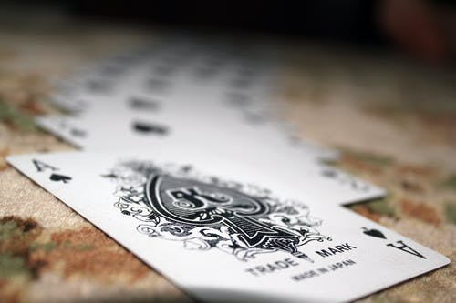 Selective Focus Photography of Ace of Spade Playing Card