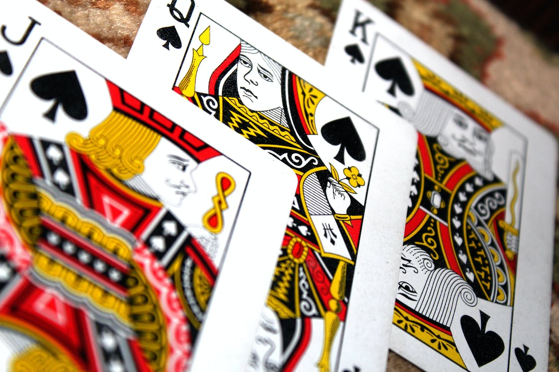 King, Jack, And Queen Of Spades Playing Cards