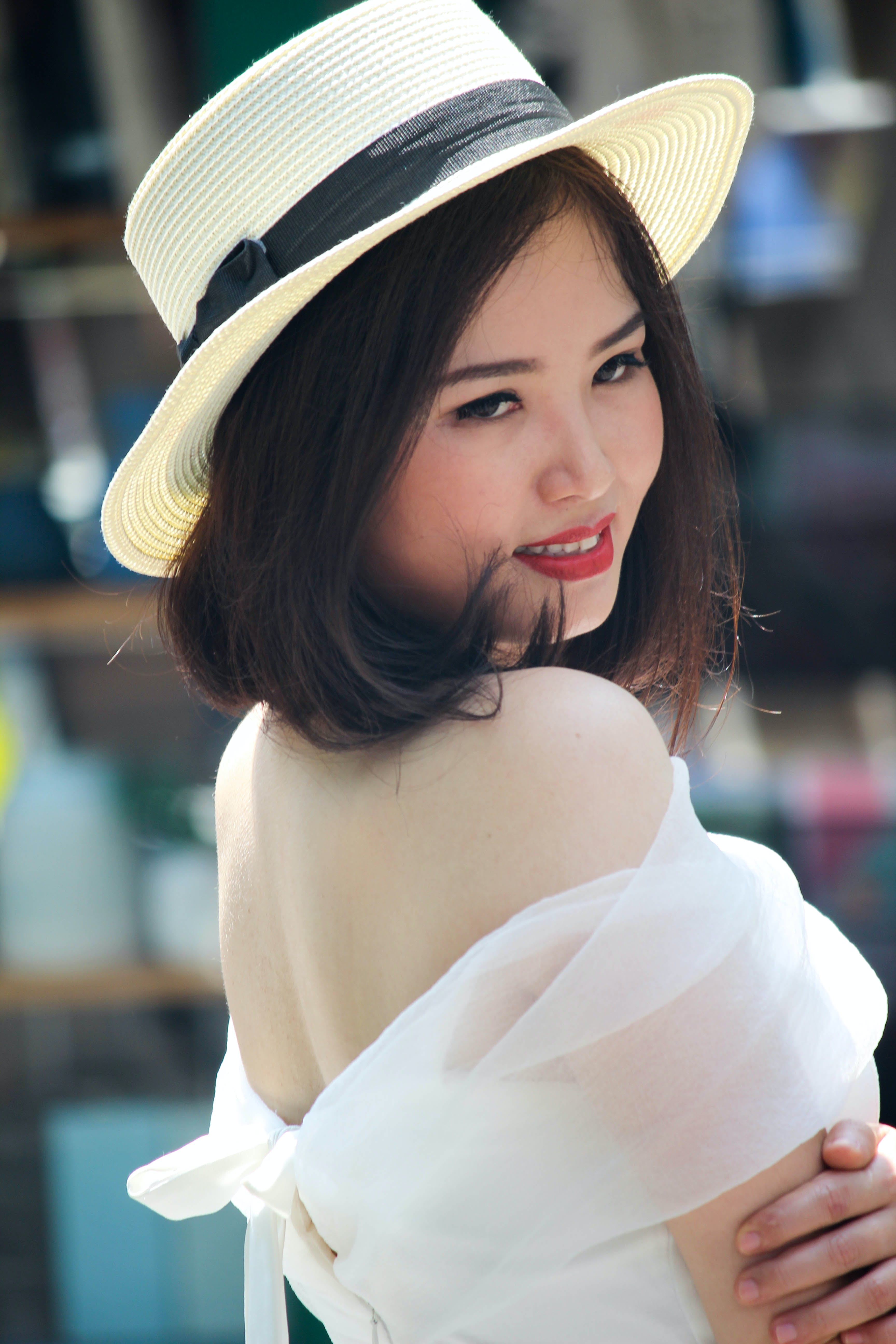 Woman In Brown Fedora Hat And White Off-shoulder Dress
