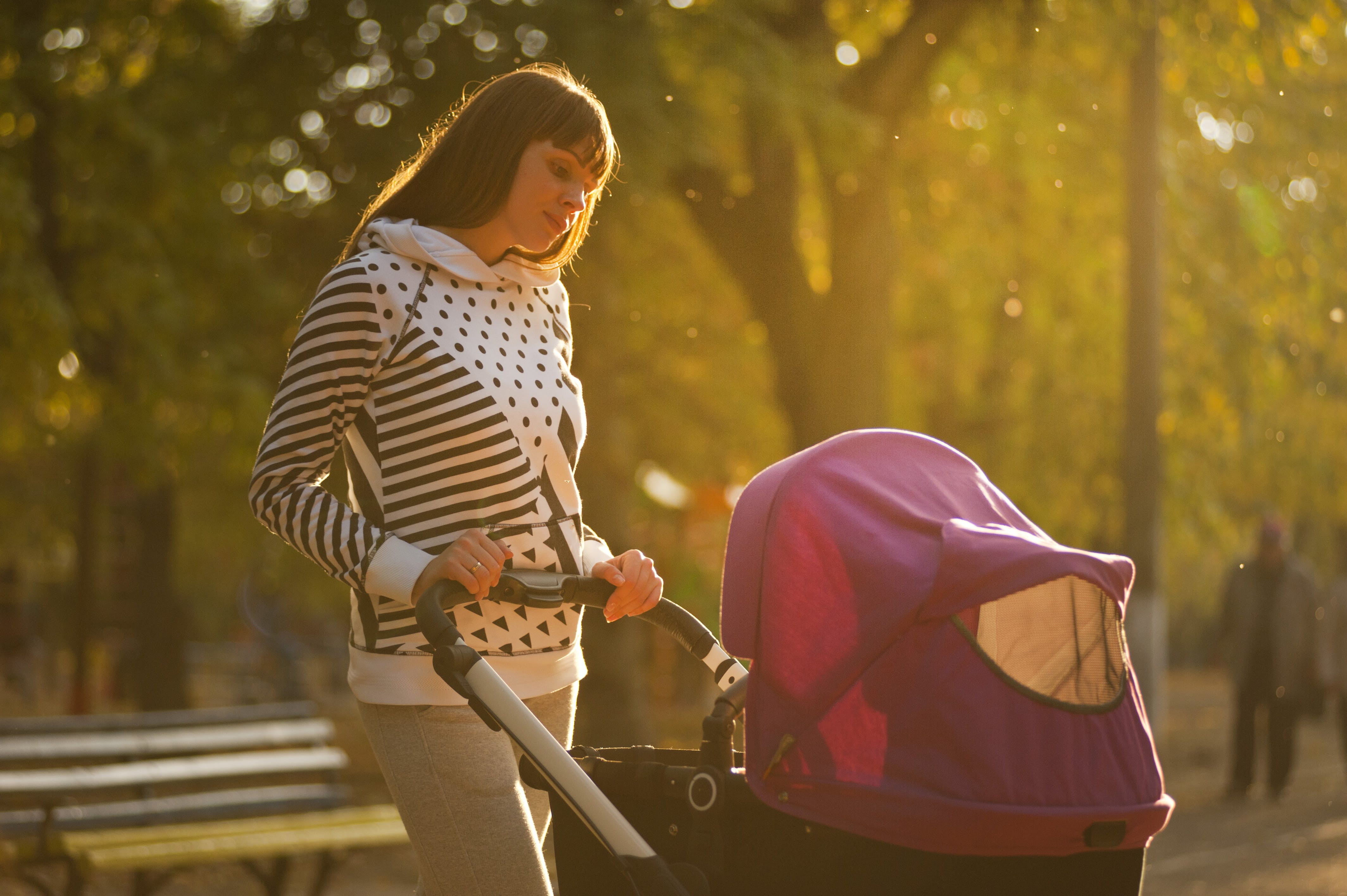 Woman Holding Pink And Black Stroller
