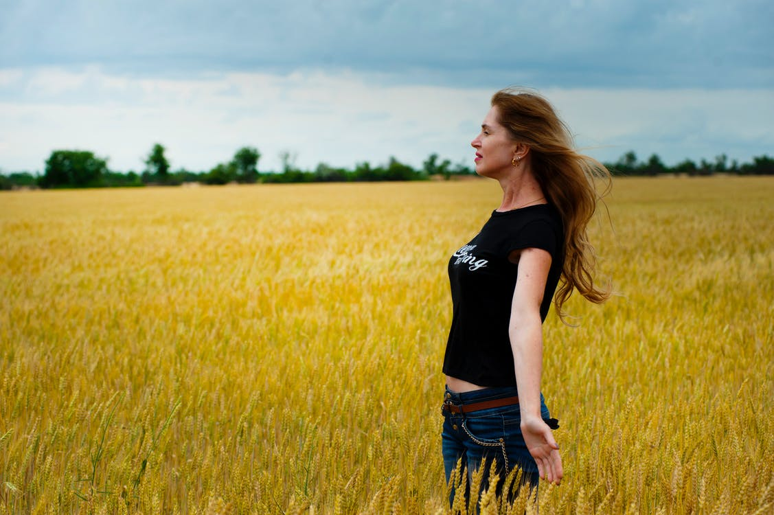 Woman Wearing Black Shirt Surrounded by Grass