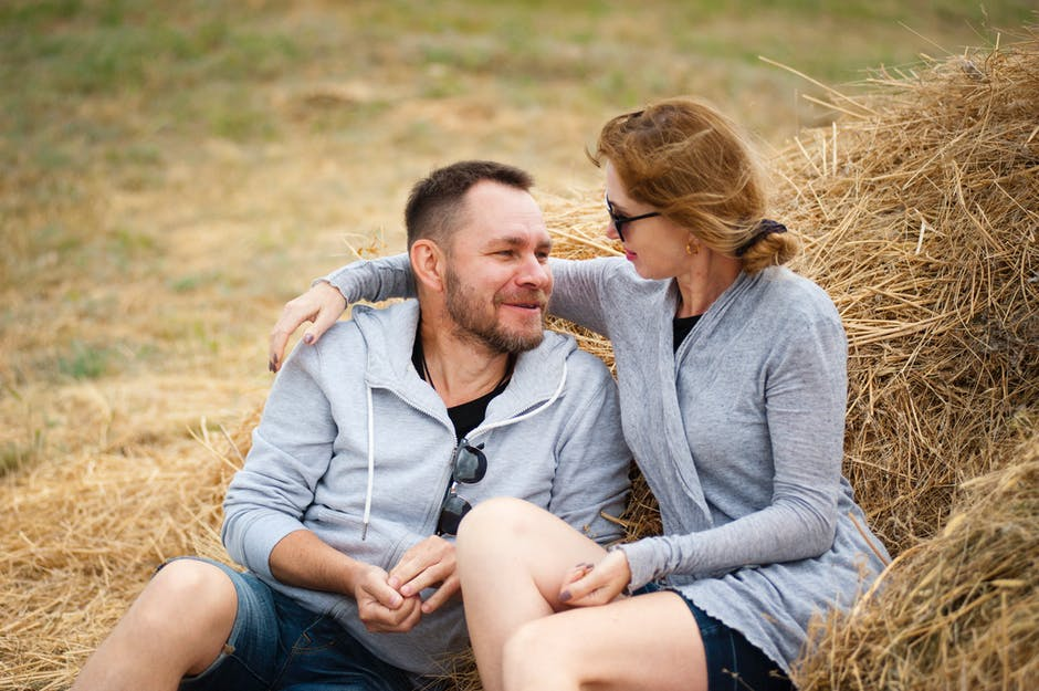 Man and Woman Sitting on Hay