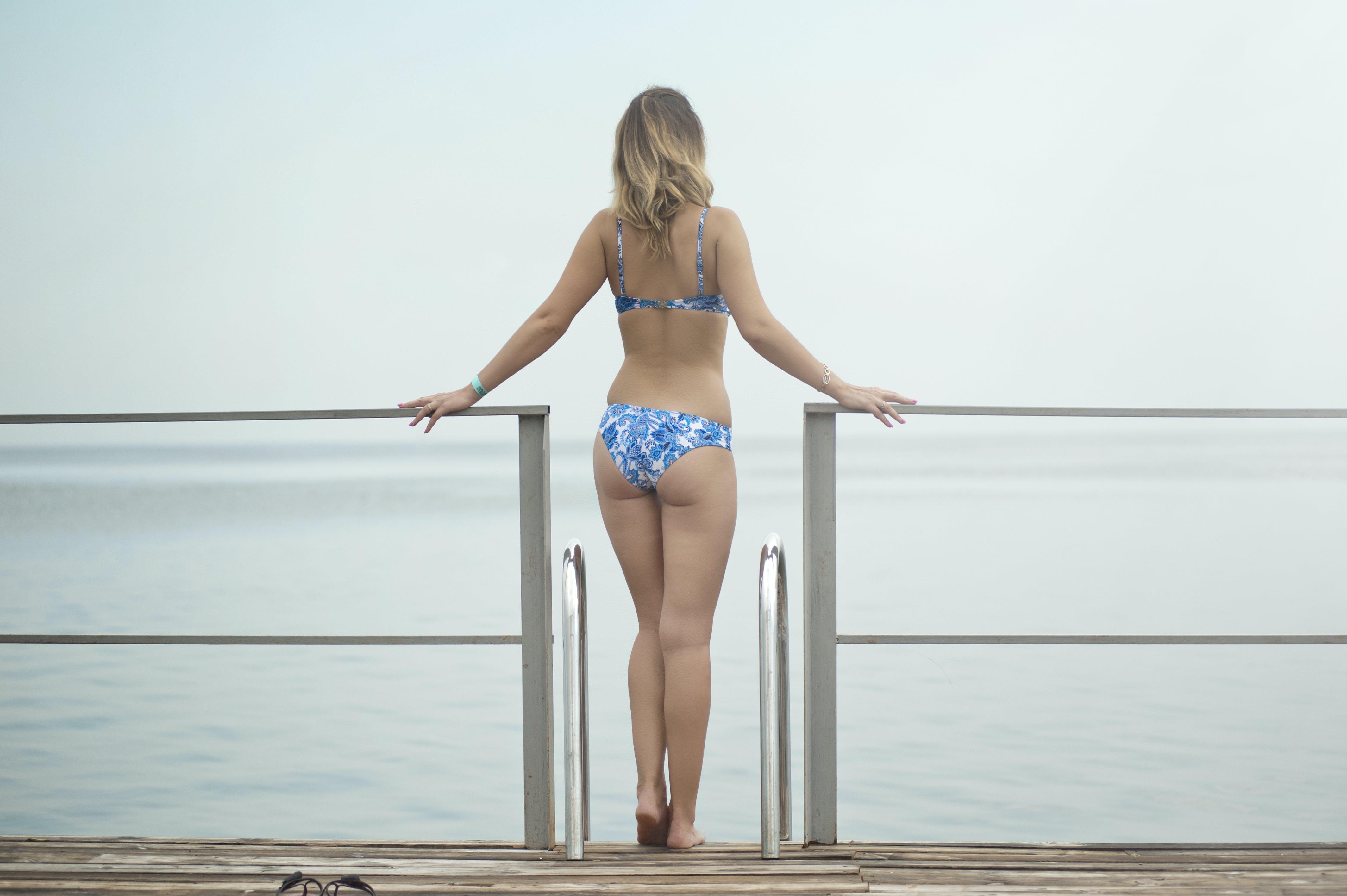 Photography of a Woman Wearing Blue Bikini