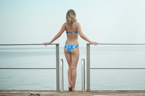 Photography of a Woman Wearing Blue Bikini