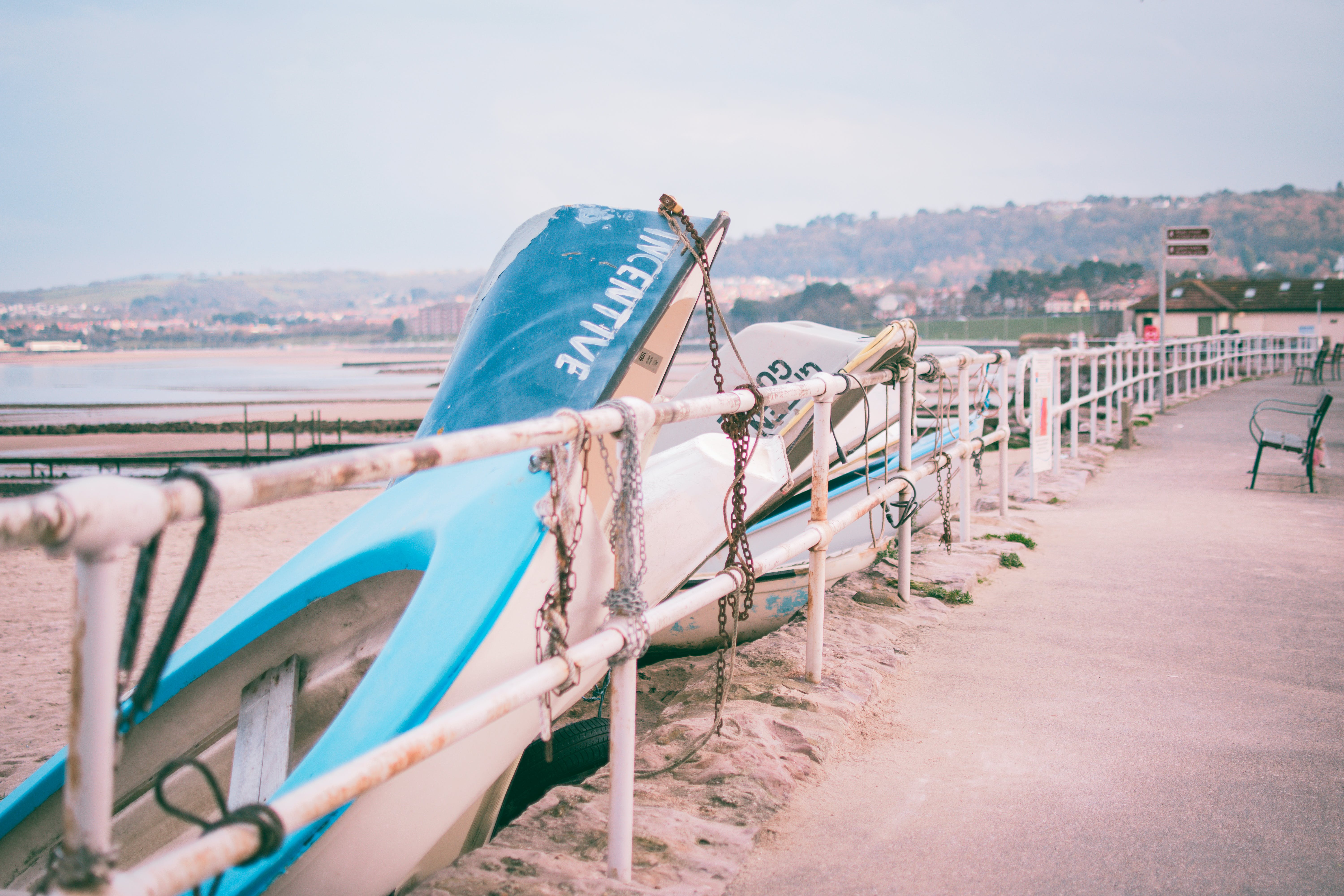 Photo of White and Blue Boats Beside White Railings