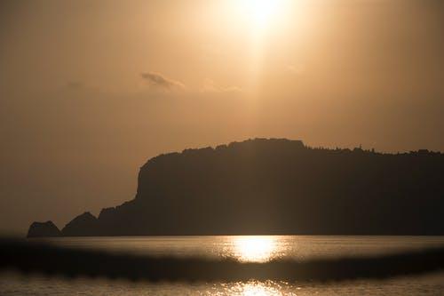 Photos gratuites de bord de mer, coucher de soleil, dinde, heure dorée