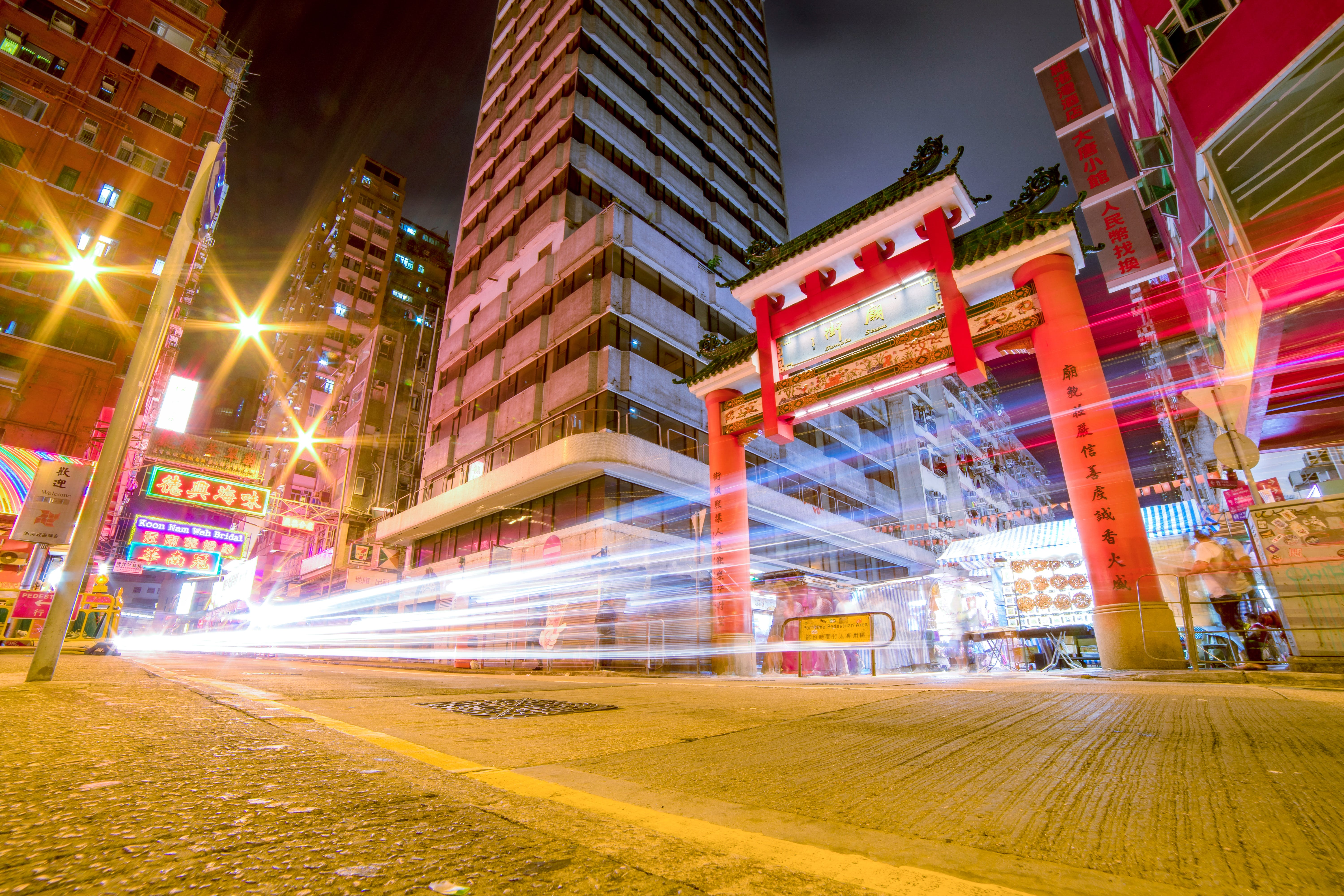 Time Lapse Photography Of Vehicles Passing Through China Town