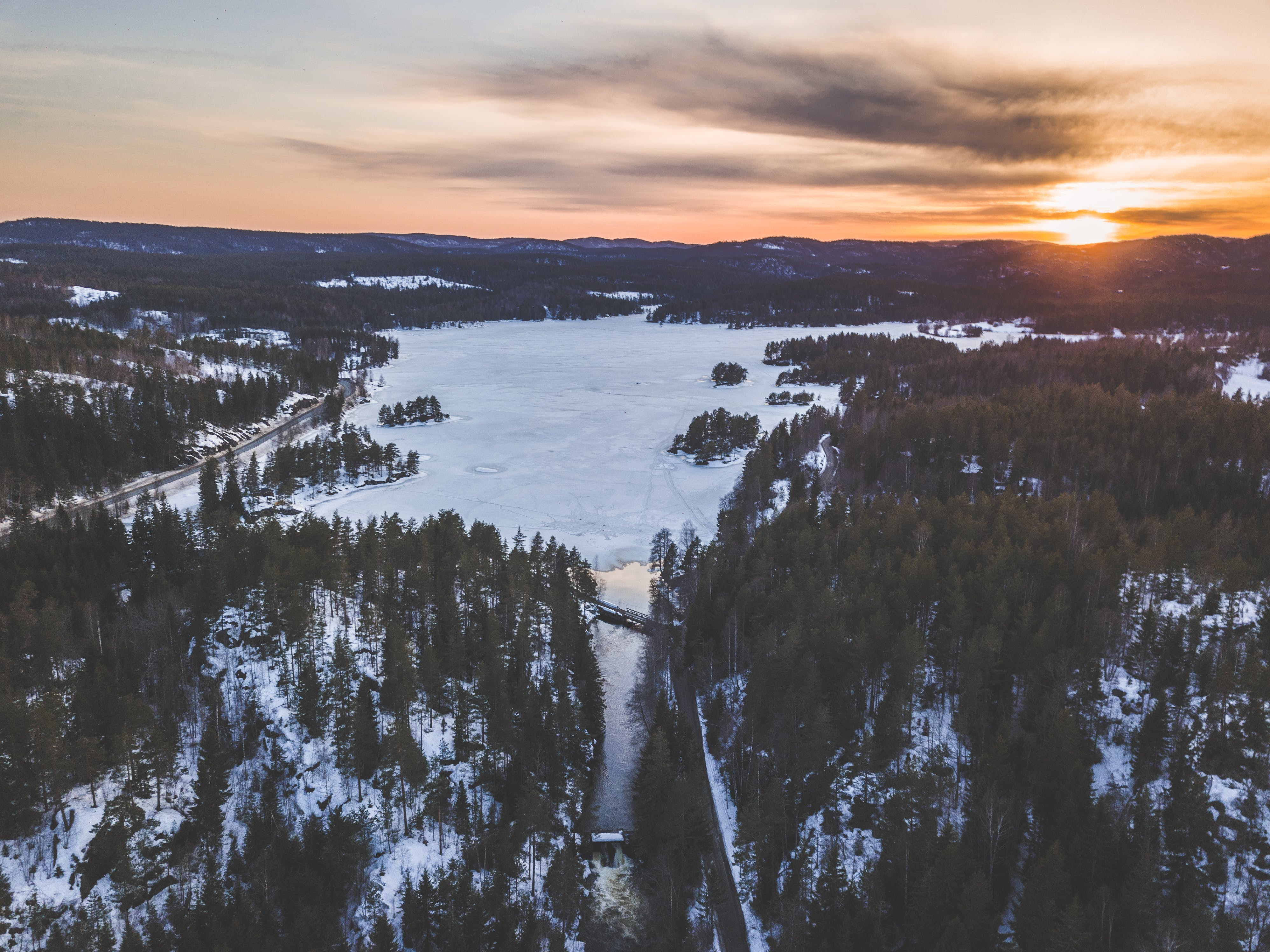 Aerial Photo Of Snowy Forest During Sunset