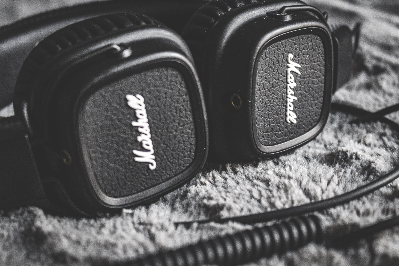 Grayscale Photography of Black Marshall Headphones