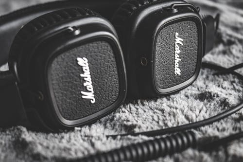 Grayscale Photography of Black Marshall Headphones