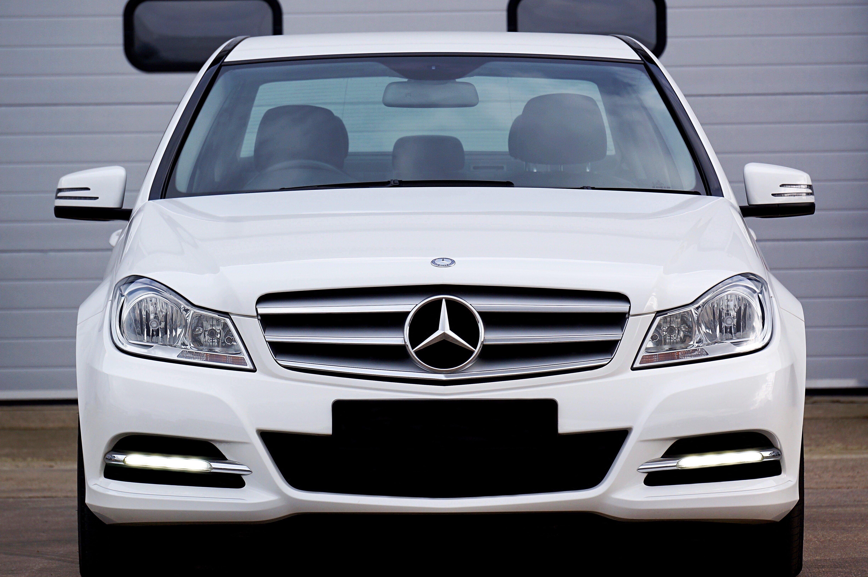 White Mercedes-benz Car Near Grey Building