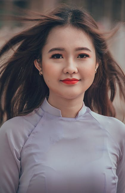 Woman wearing white long sleeved shirt selective focal photo