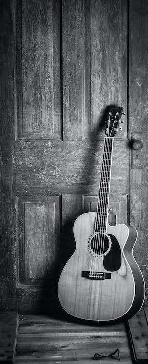 Brown and Black Cut-away Acoustic Guitar