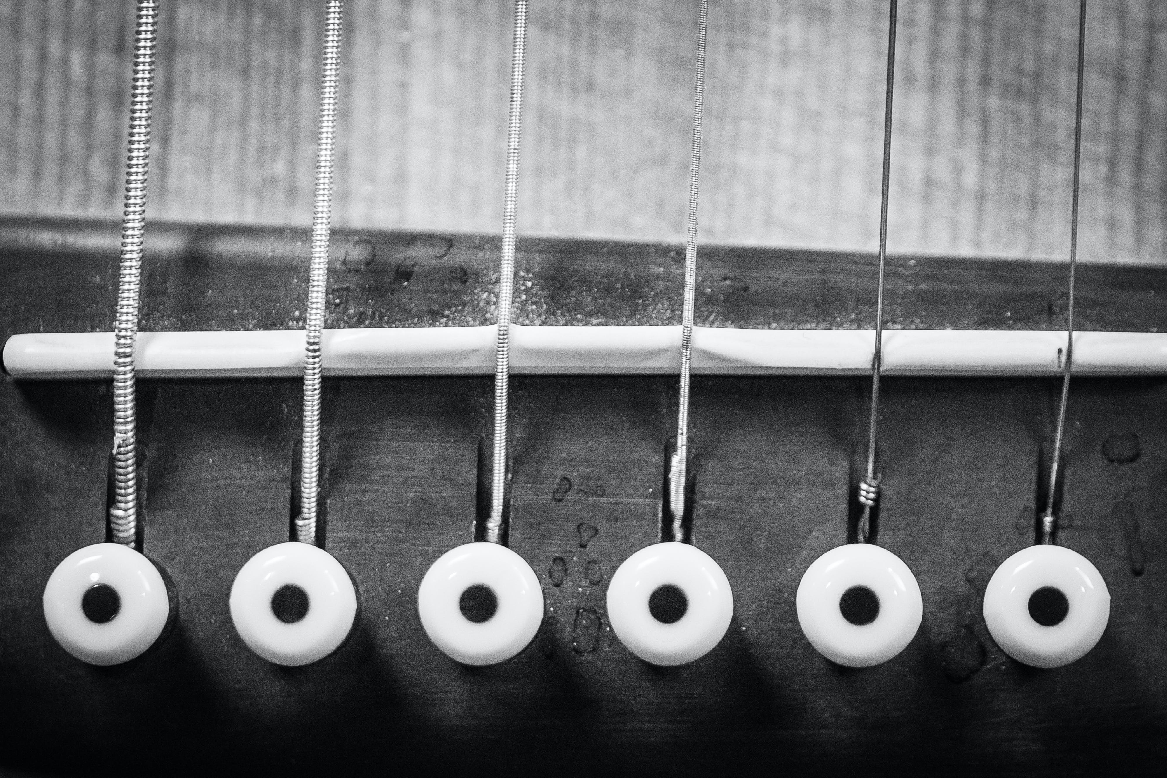 Closeup Grayscale Photo of Acoustic Guitar