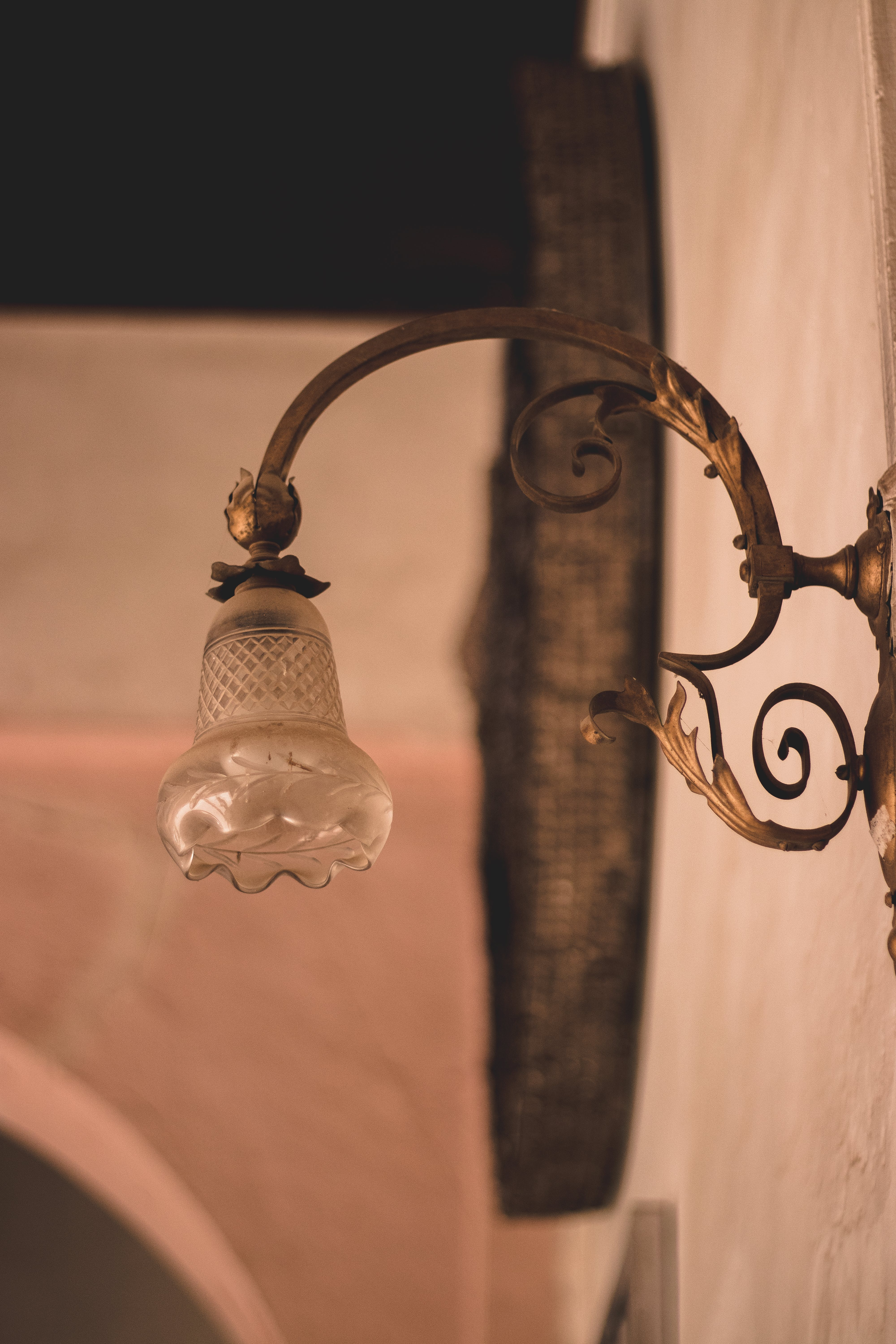 Selective Focus Photography of Brown Framed Sconce
