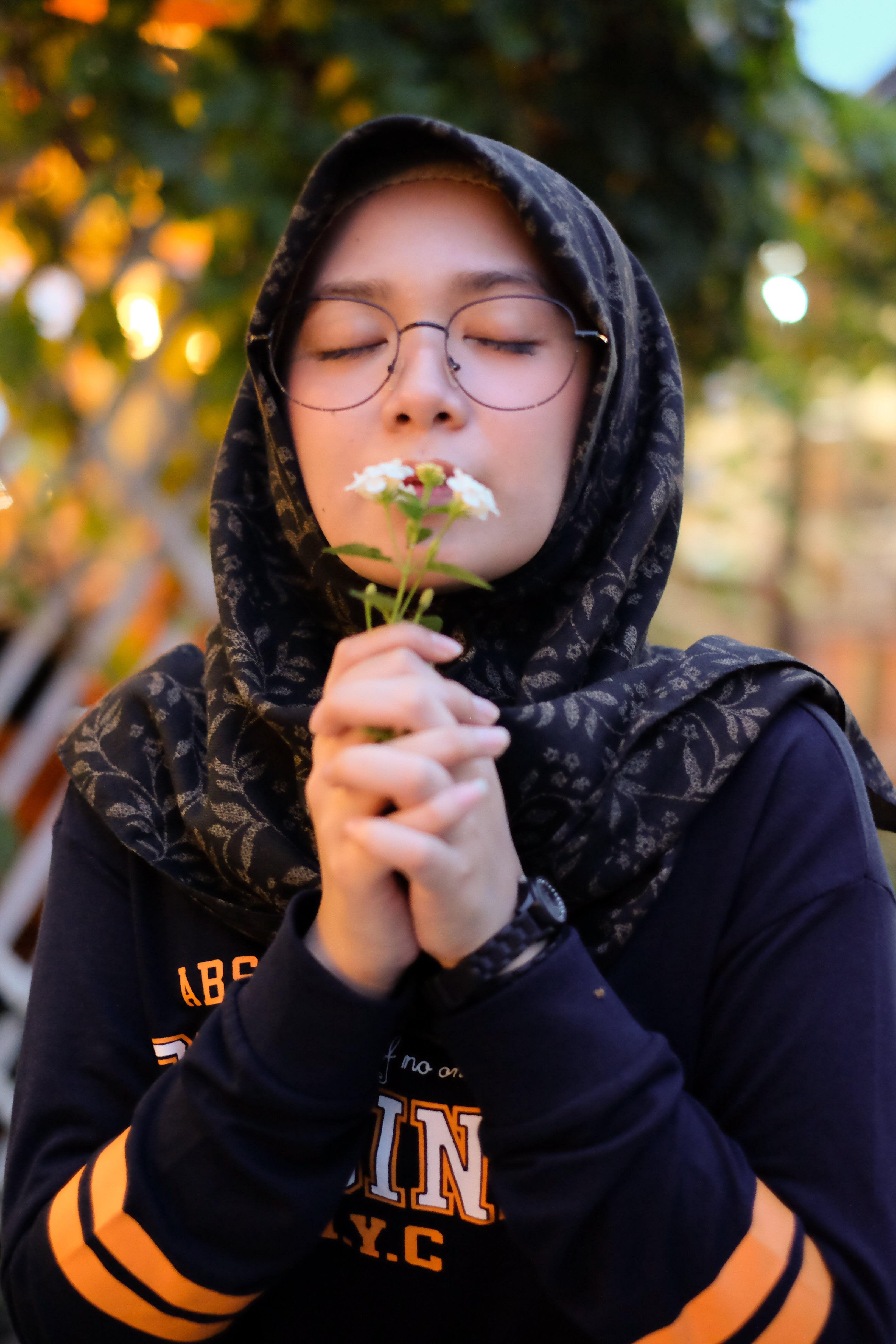 Photo of Girl Smelling White Petaled Flowers