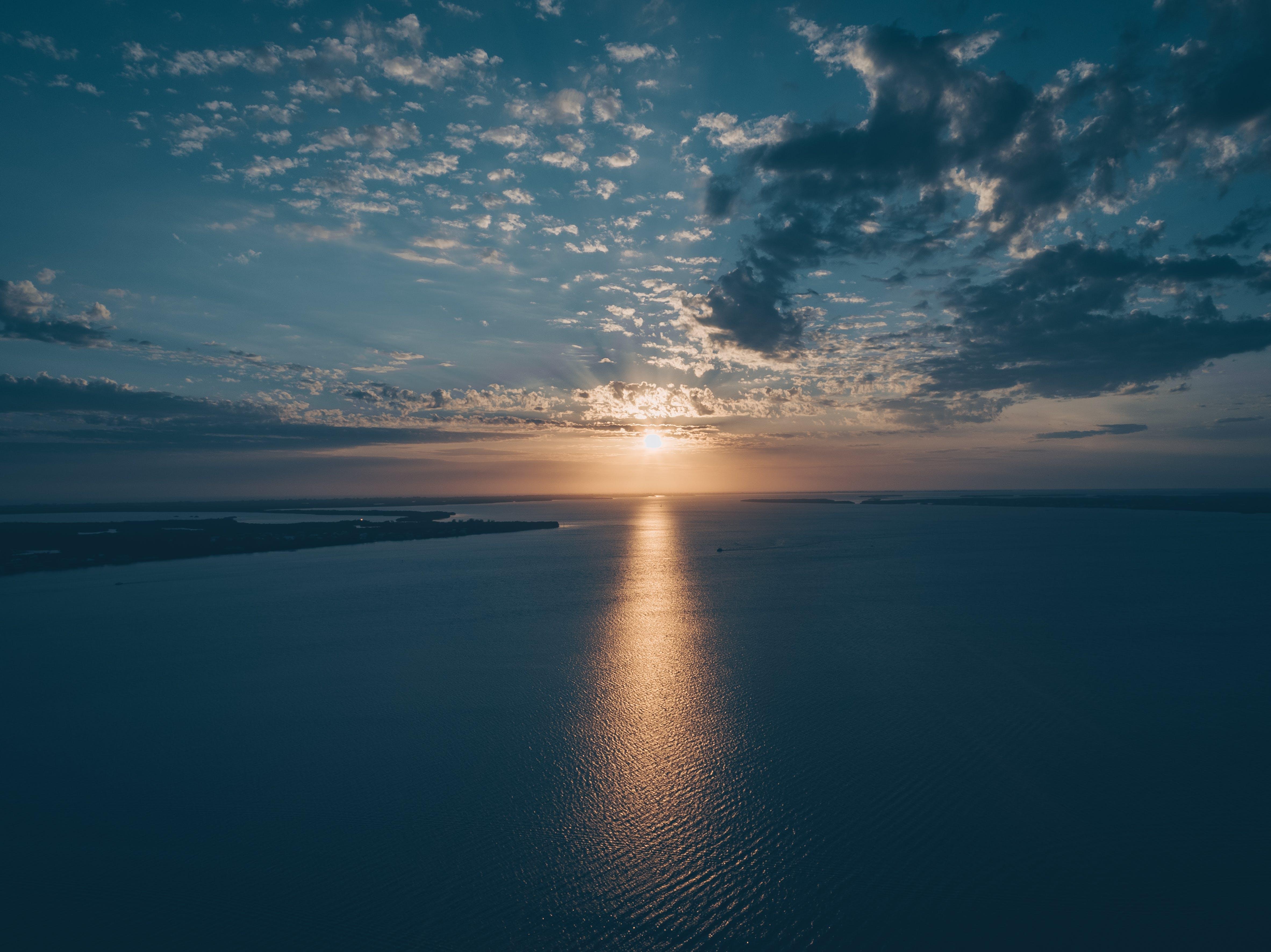 Bird's Eye View of Ocean During Sunset