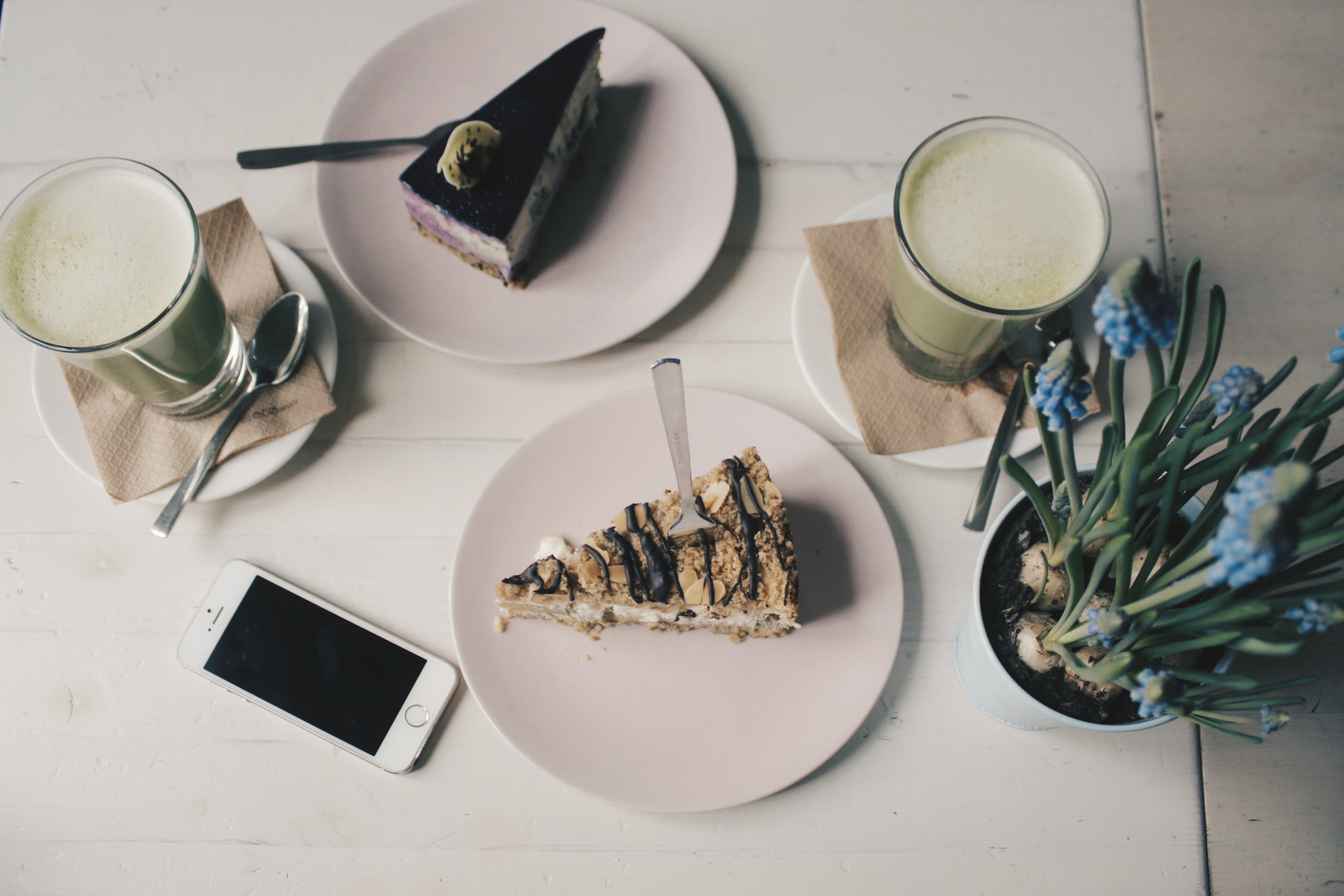Photo of Sliced Cakes and Milk tea Near Plant