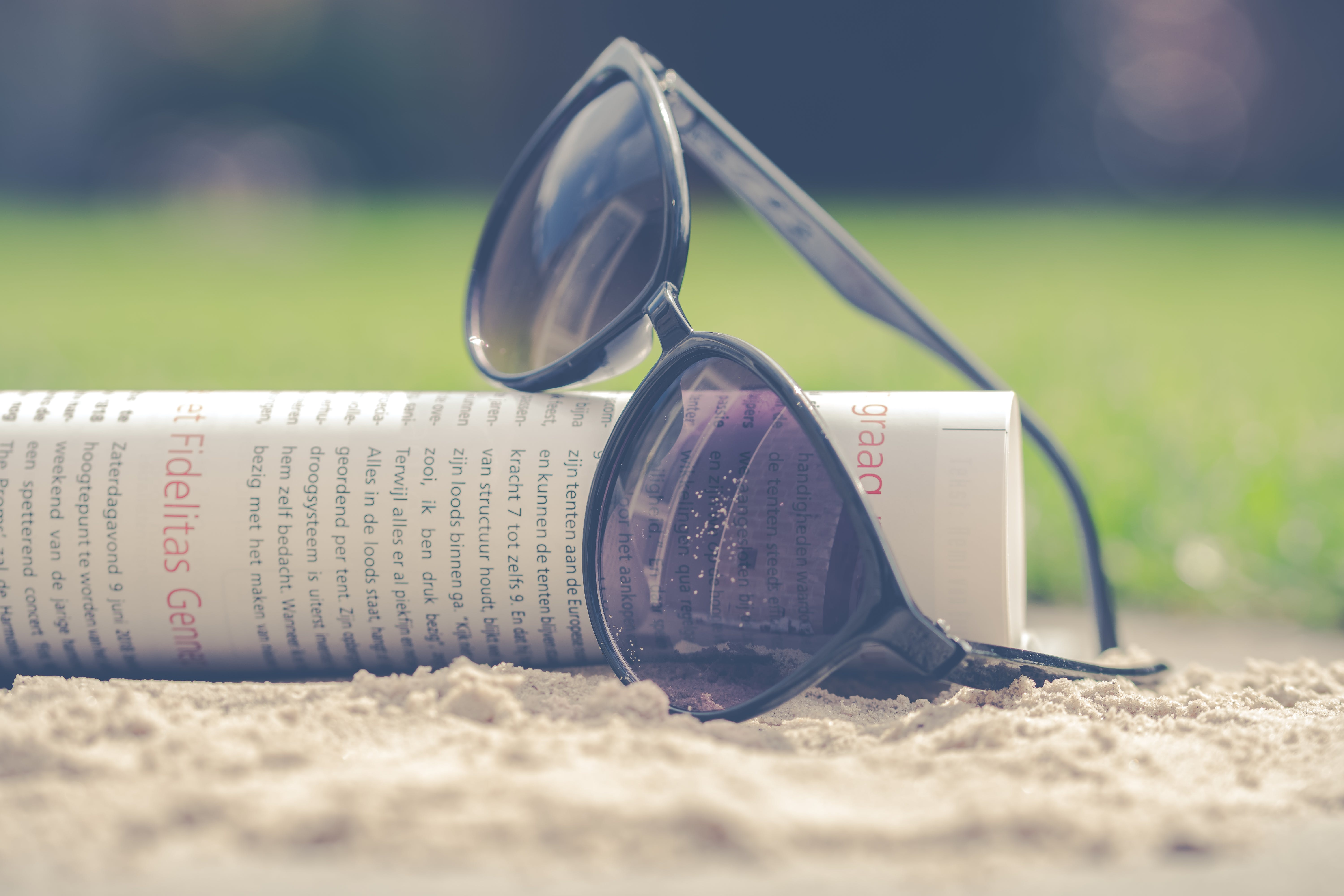 Black Sunglasses on Book