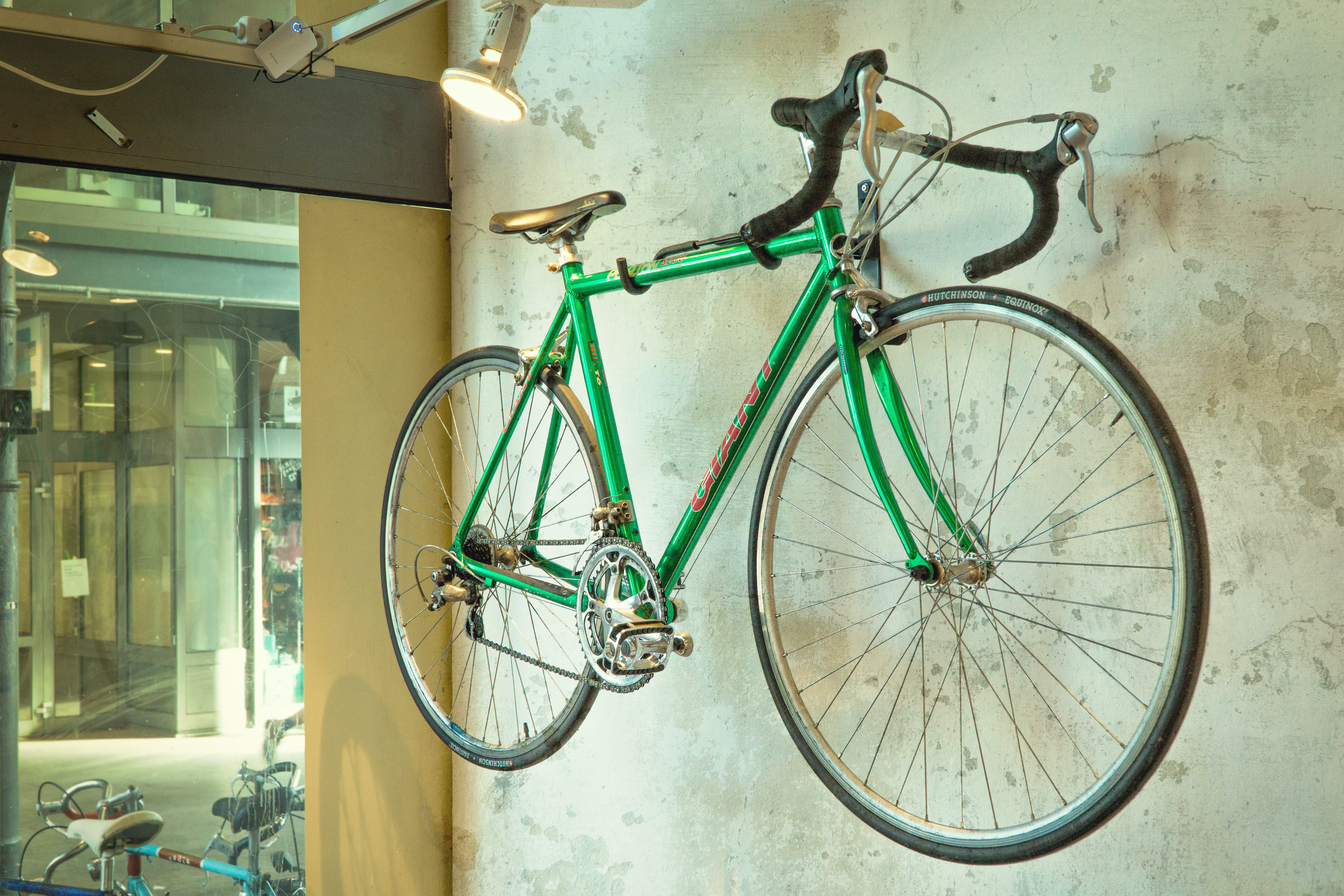 Green Road Bicycle Hanged on Wall