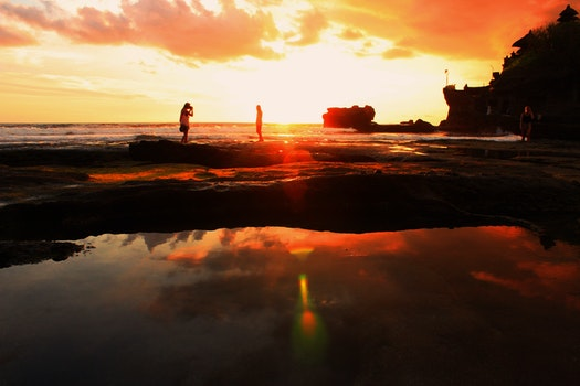 People on Low Tide during Sunrise