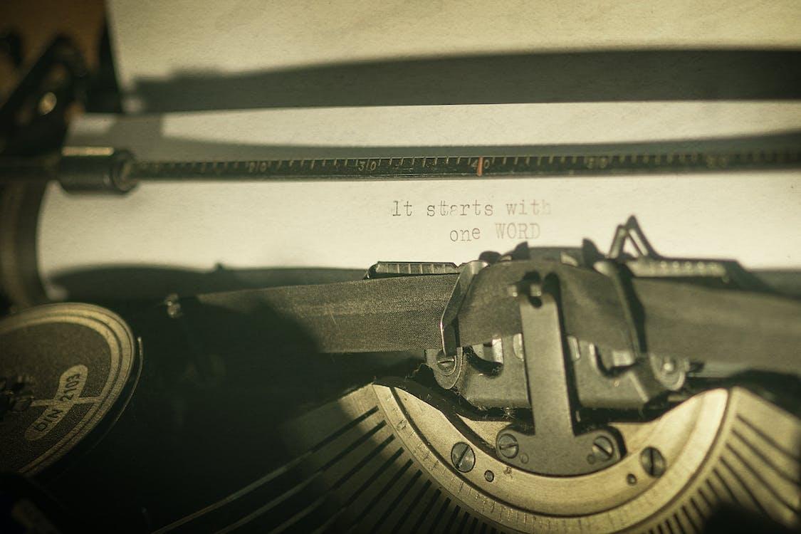 Gray Typewriter and White Printer Paper
