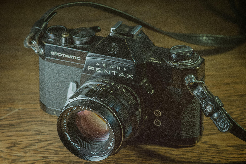 Black Pentax Digital Camera on Brown Surface
