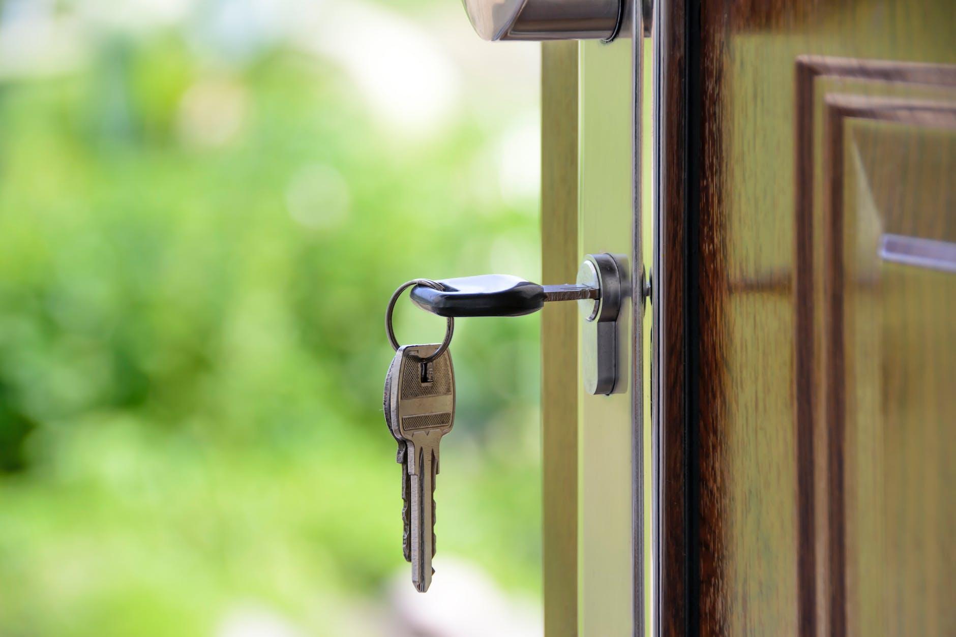 Black handled key in key hole (public domain image)