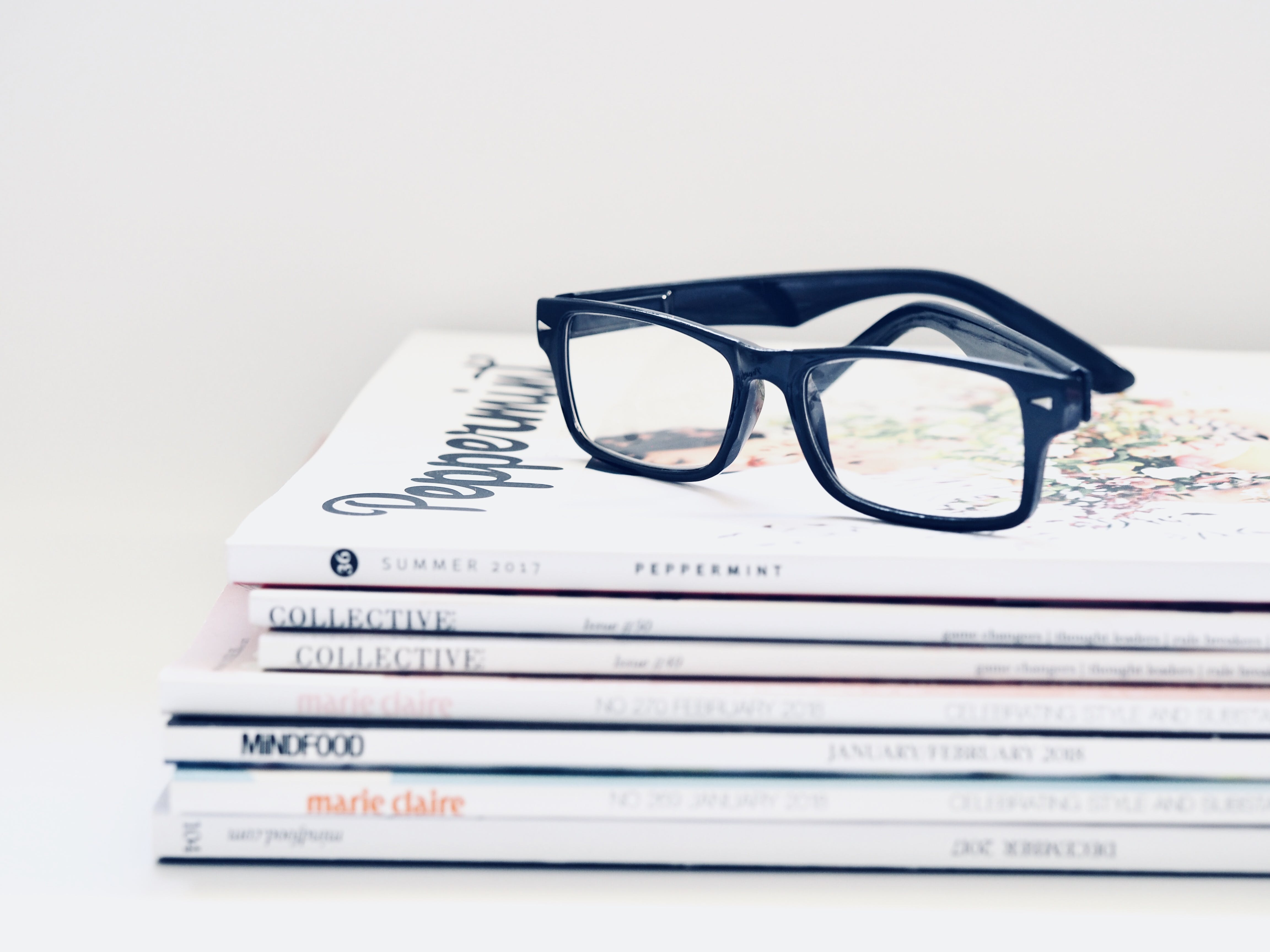 Black Framed Eyeglasses on Seven Collective Books
